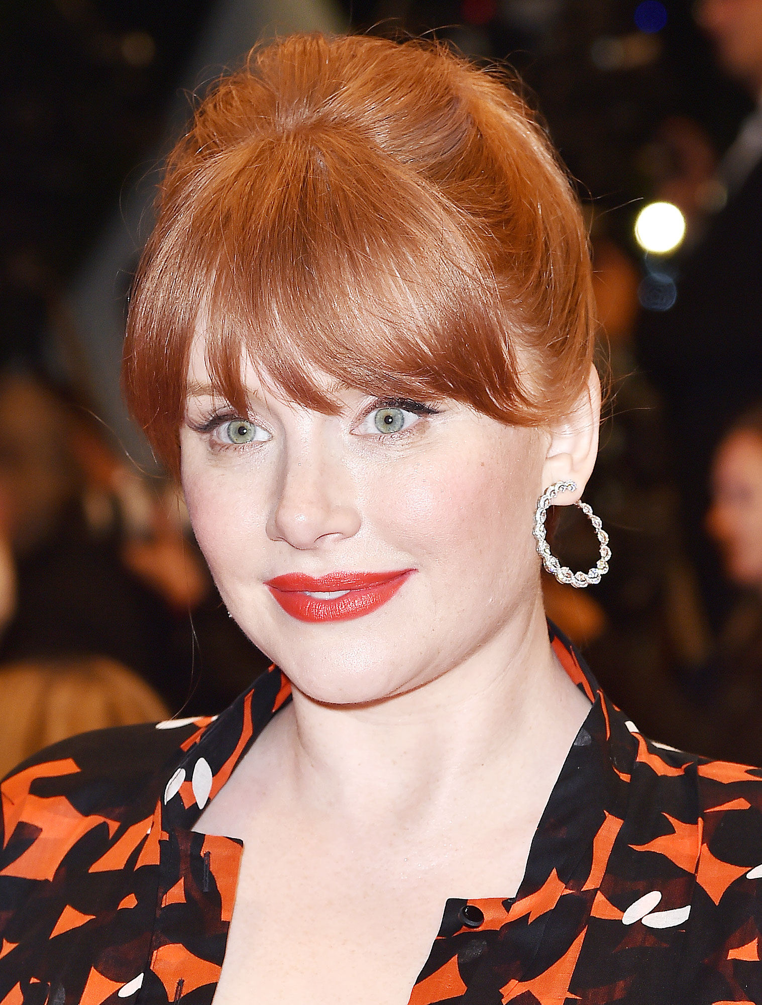 Bryce Dallas Howard Cannes Film Festival Real Real Consignment Red Black Dress - Playing off the boldness of the dress, Yoshimoto Bua warmed up Howard's porcelain complexion with a rosy blush, defined her eyes with a graphic black cat eye and made her pout pop with a cherry red shade.