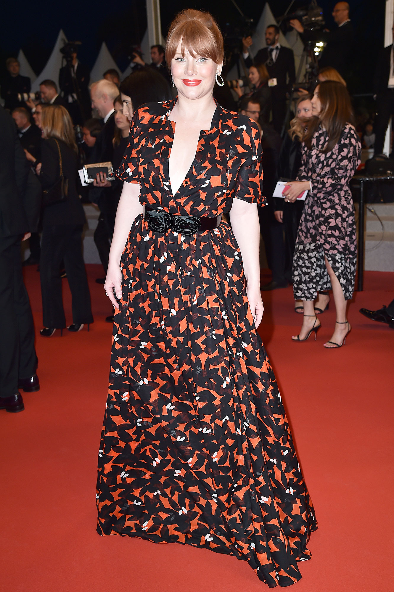 Bryce Dallas Howard Cannes Film Festival Real Real Consignment Red Black Dress - In need of a slightly more glamorous ensemble for the film's premiere on Thursday, May 16, the Rocketman star found a black-and-red vintage Gucci maxidress on The RealReal that she cinched with a Reem Acra belt. She shared on social media that the cotton fabric kept her cool on the steamy South of France red carpet, while Prada platforms and Chopard jewels completed the look.