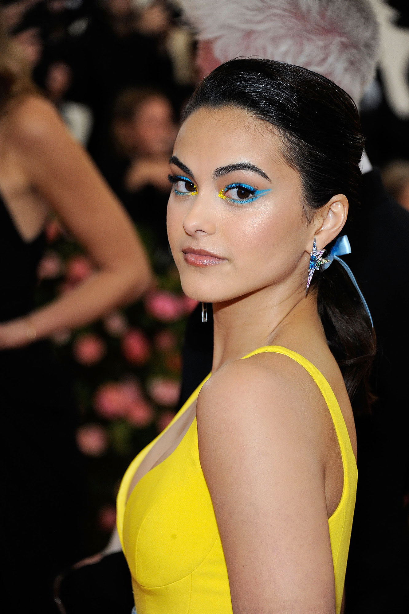 Camila Mendes Fresh Cat Eye - The Riverdale star stunned at the 2019 Met Gala with a pigmented eye. The standout makeup was created by Beau Nelson, who used the Covergirl TrueNaked Dazed Palette for the inner gold and Covergirl Get In Line eyeliner in Teal Crystal for the extra intense pop of blue.