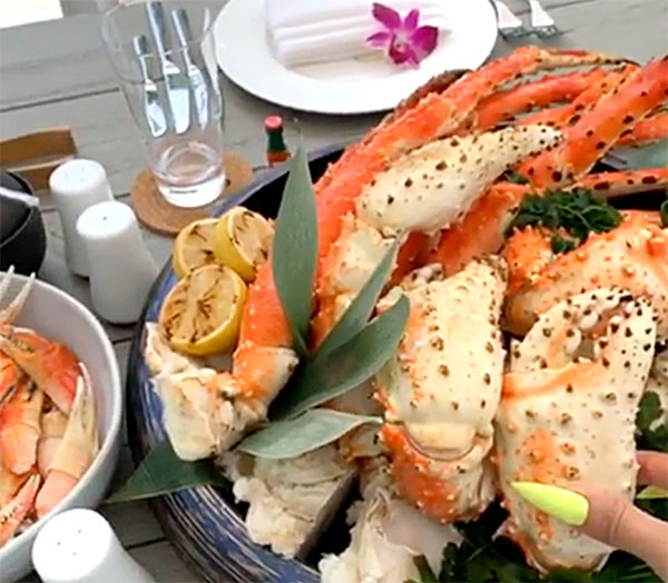 "Cardi B's Mother's Day Feast - Speaking of crustaceans, a separate table outside housed a massive platter of crab claws and crab legs, which is one of Cardi's favorite foods. ""Thank you babe, I love you,"" she told Offset."