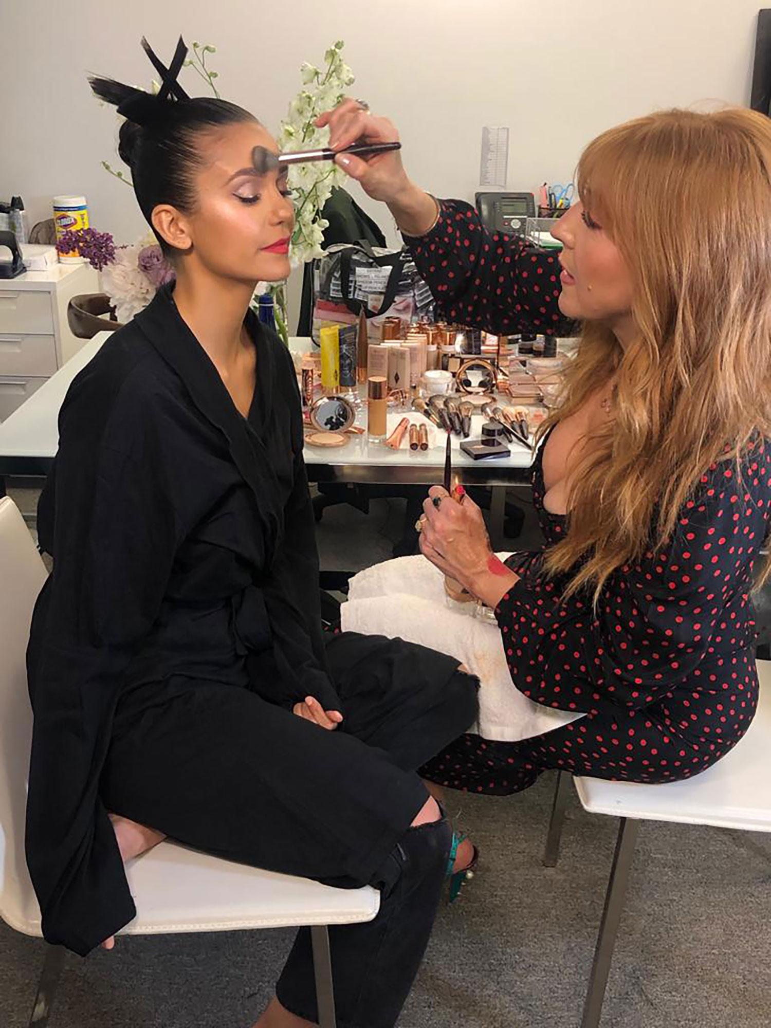 "A Behind-the-Scenes Look at Celeb Makeup Artist Charlotte Tilbruy's Met Gala - Creating a bit of ""makeup magic"" to complement Nina Dobrev's fun and flirty Zac Posen minidress, Tilbury shares she had ""such fun getting ready with Nina."""