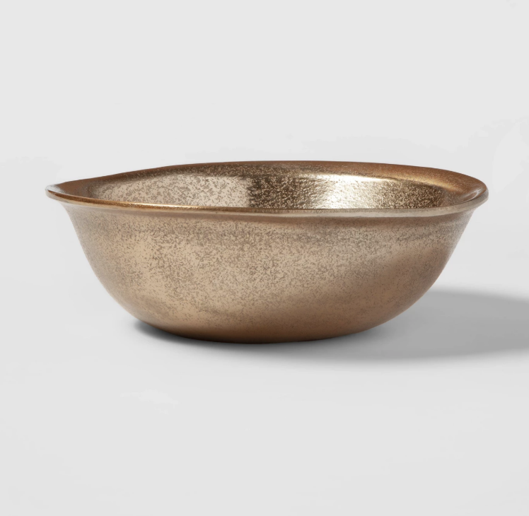 """10"""" Rough Aluminum Bowl - Gold Chrissy Teigen Explains Personal Significance Behind New Cravings Pieces - The Deal or No Deal alum said she loves to """"toss a big salad"""" in this luxe, 10-inch gold dish. According to Teigen, the bowl was inspired by """"bazaar-type shops with pieces stacked high with their own individual nicks, dents and flecks of paint."""