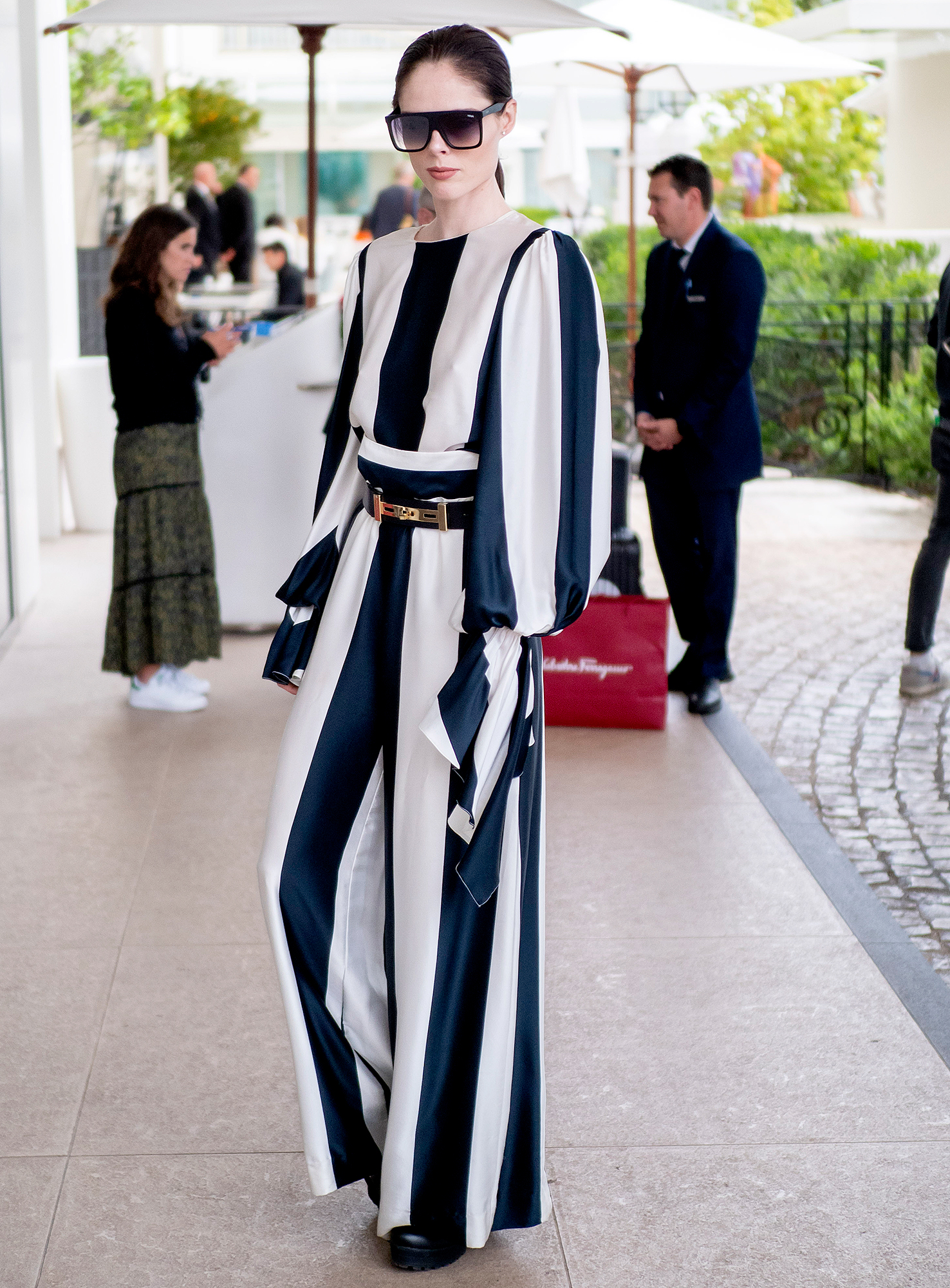 Coco-Rocha - Showing her stripes on her way to her hotel on Monday, May 20, the model rocked a blue-and-white top and trousers set.