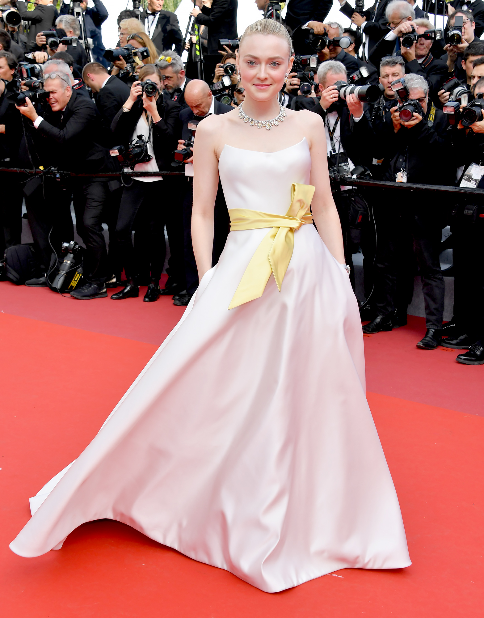 Dakota-Fanning - A yellow sash brightened up the blonde beauty's white strapless Armani gown at the Once Upon a Time in Hollywood premiere on Tuesday, May 21.