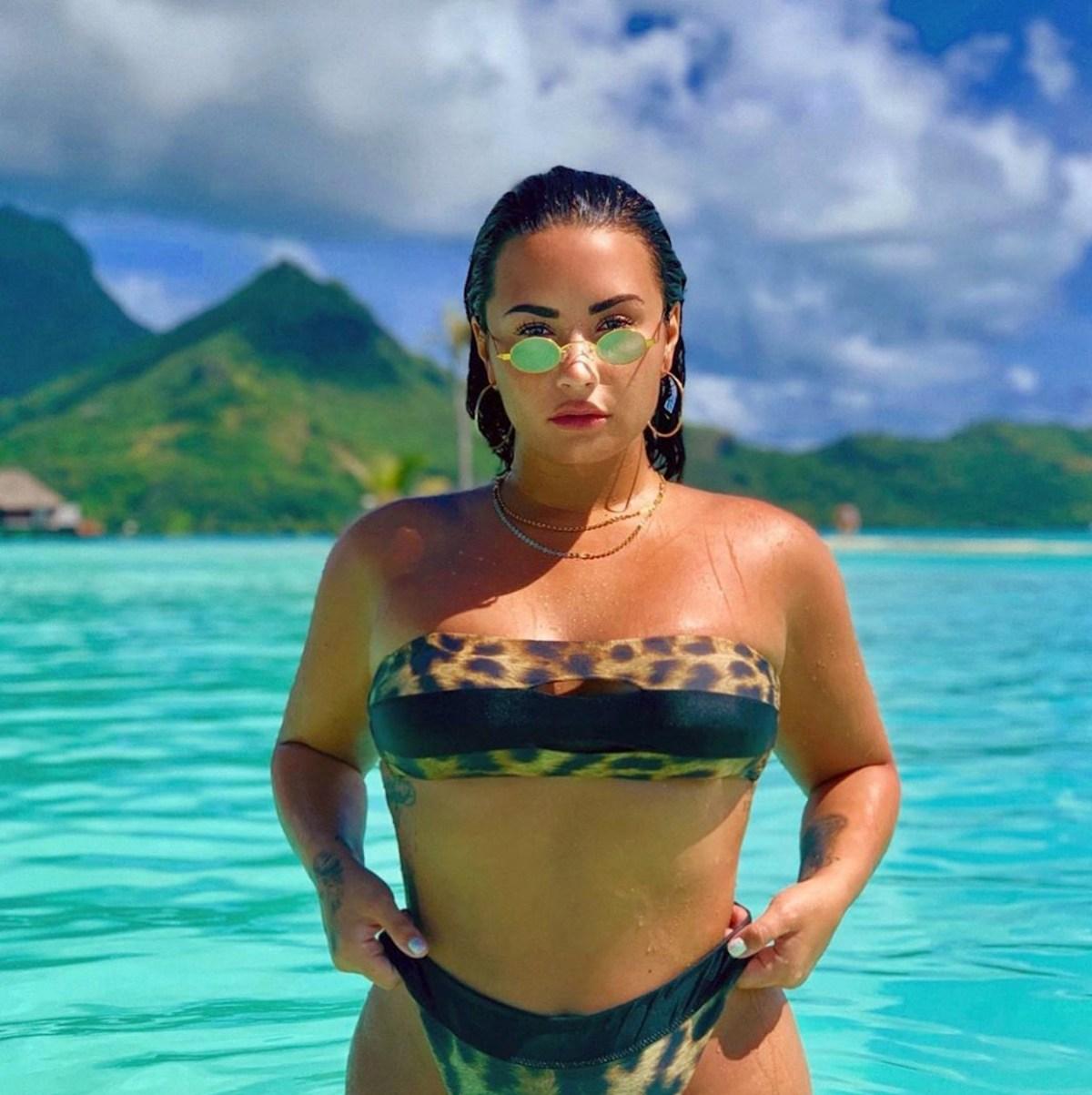 1233e6855a32 Demi Lovato Continues to Post Pics in Leopard Bikini in Bora Bora