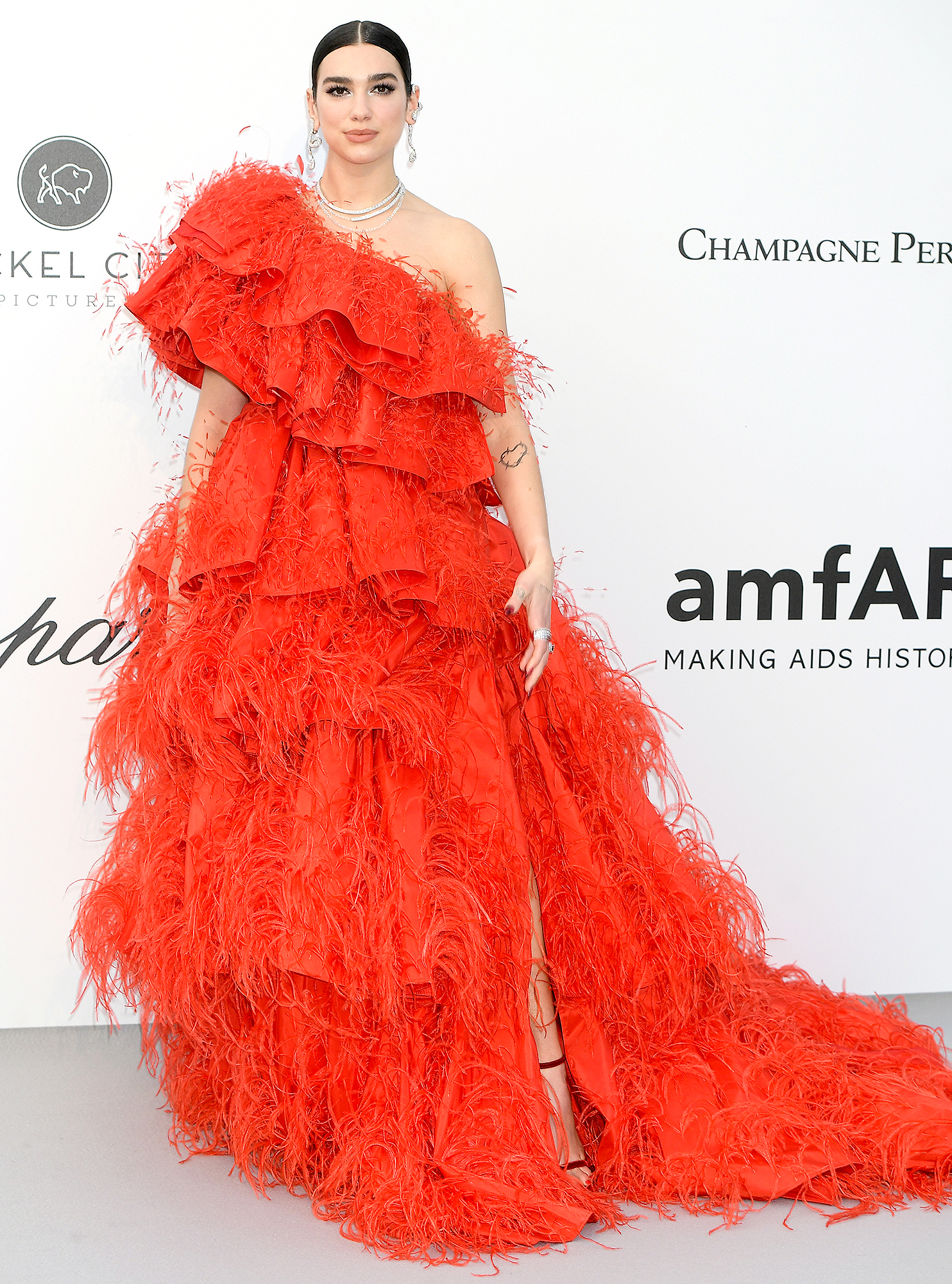 Dua-Lipa - We're getting scarlet fever from the songstress' voluminous Valentino gown at the amfAR Cannes Gala on Thursday, May 23.