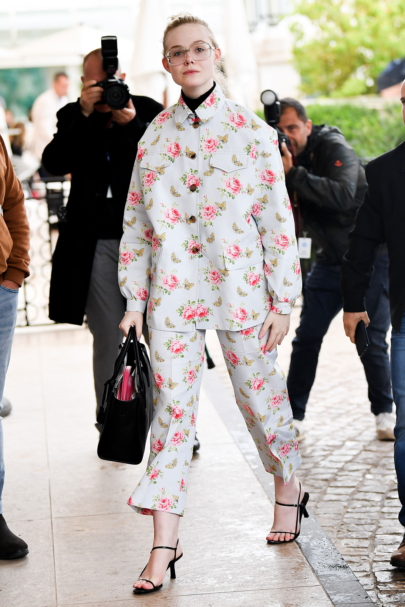 Elle Fanning Stepping Out in Style at Cannes Film Festival - It was all about the flower power for the blonde beauty in her two-piece ensemble on Saturday, May 18.