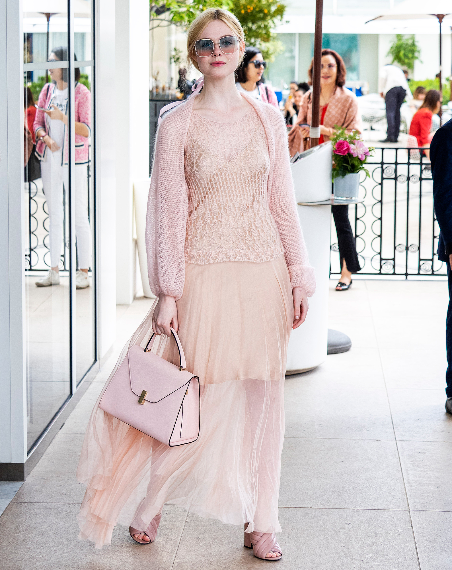 Elle-Fanning - Monochrome dressing at its finest, the jurist was pretty in blush pink separates on Thursday, May 23.