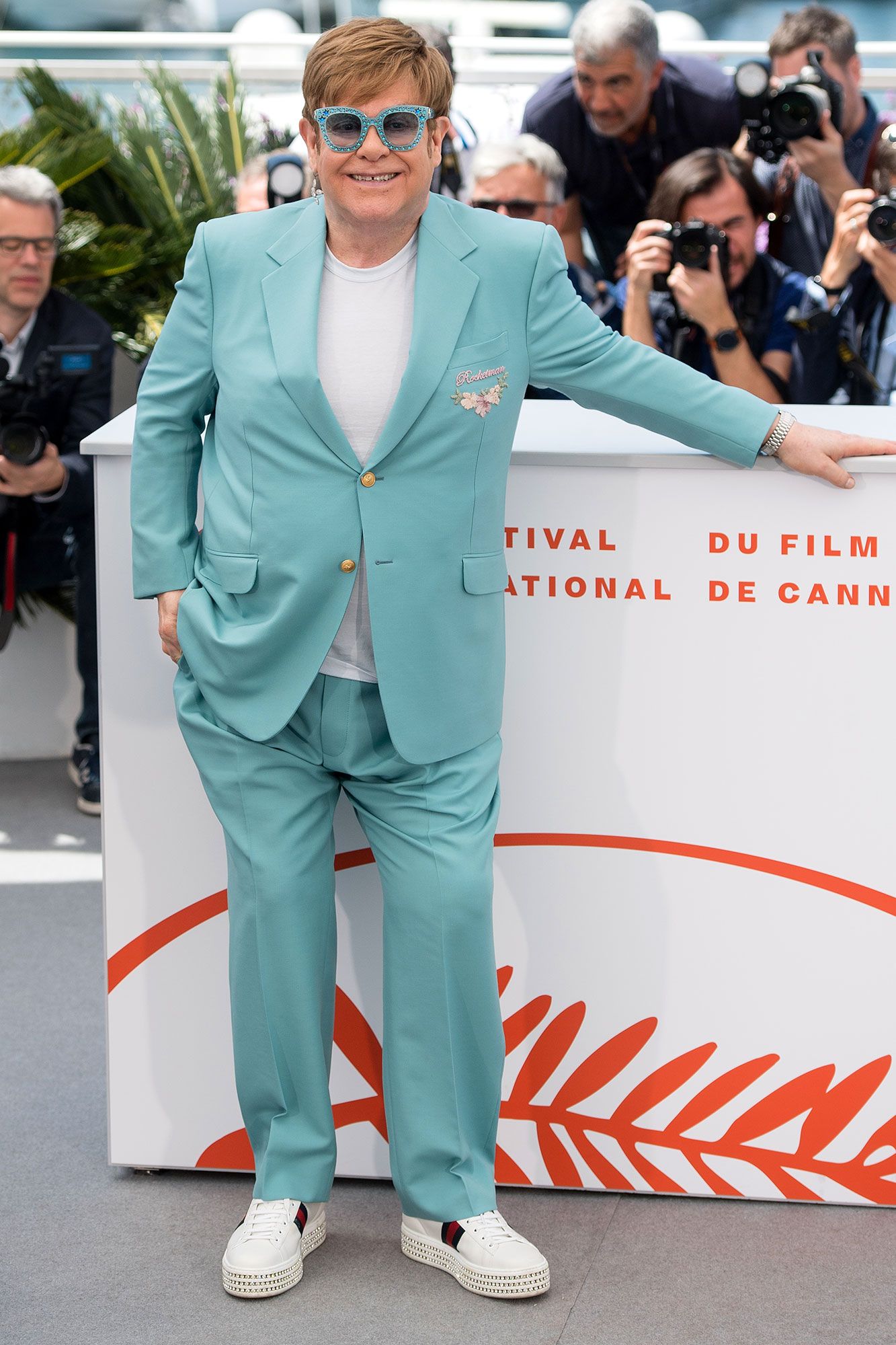 Elton John Cannes Film Festival 2019 Most Stylish Guys Red Carpet - When in doubt, match your crystal-embellished glasses to your pastel suit as the music legend did at the Rocketman photo-call on Thursday, May 16.