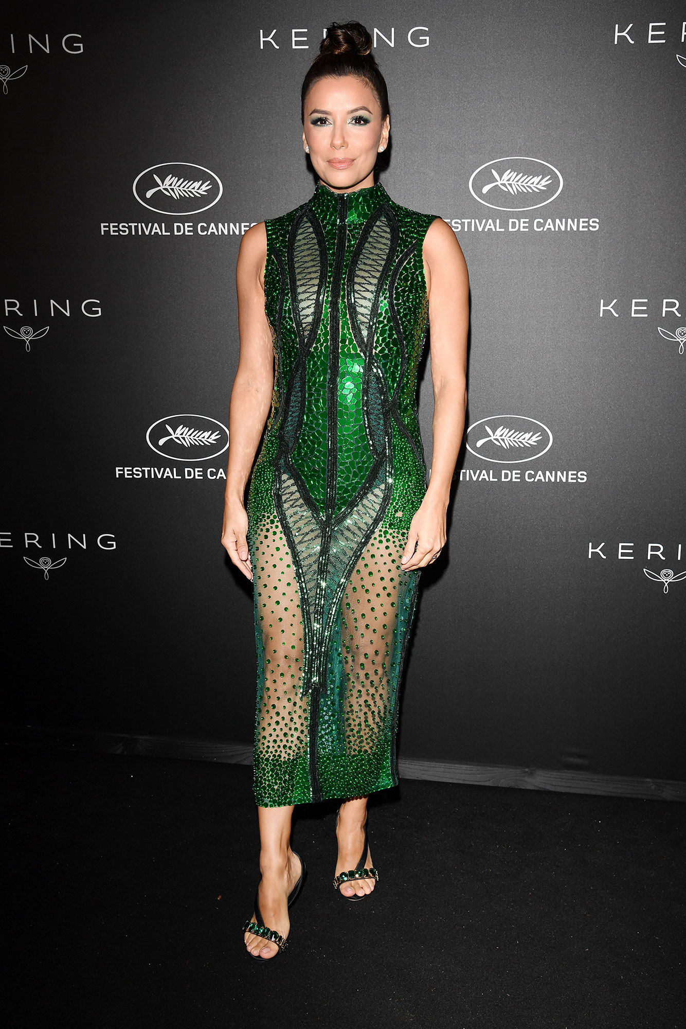 Eva Longoria Stepping Out in Style at Cannes Film Festival - The only thing better than the actress' sexy Atelier Zuhra midi and Olgana Paris jewels at the Kering dinner on Sunday, May 19? Her matching emerald eye makeup.