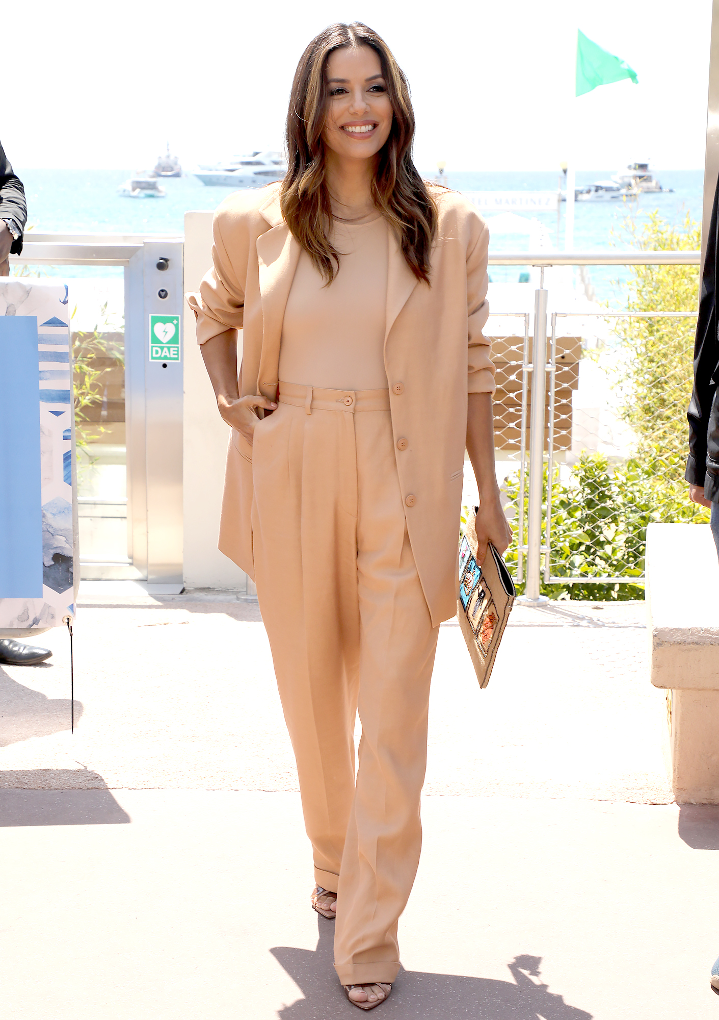 Eva-Longoria-Cannes-Festival - The L'Oreal ambassador rocked a boss-lady Rebecca Vallance pantsuit with Gianvito Rossi sandals at an event for the brand on Thursday, May 16.