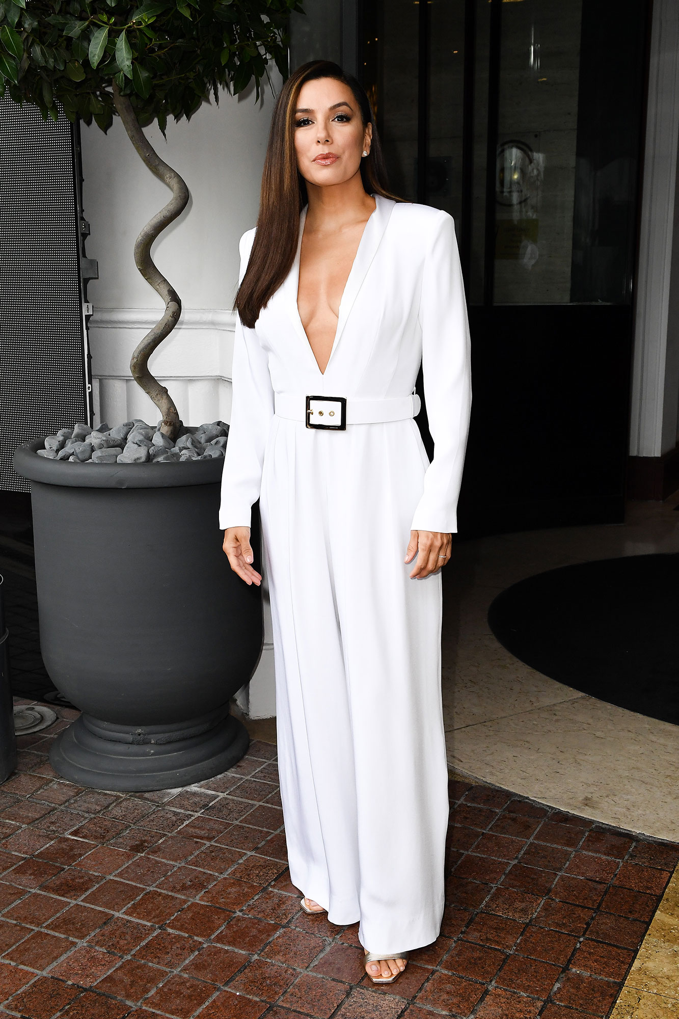 Eva Longoria Memorial Day White - This simple plunging jumpsuit the Desperate Housewives alum wore on May 18, 2019, in Cannes is the perfect formal summer wear.