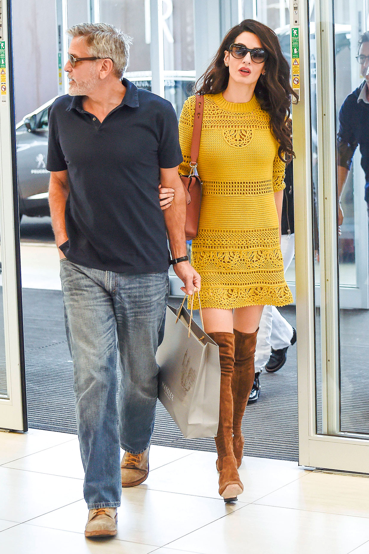 George Clooney and Amal Clooney - Spotted leaving a hotel in Rome (where she's staying to help hubby Clooney promote Catch 22 ) on May 14, 2019, the civil rights lawyer looked seriously chic in a crocheted yellow minidress with over-the-knee brown suede boots.