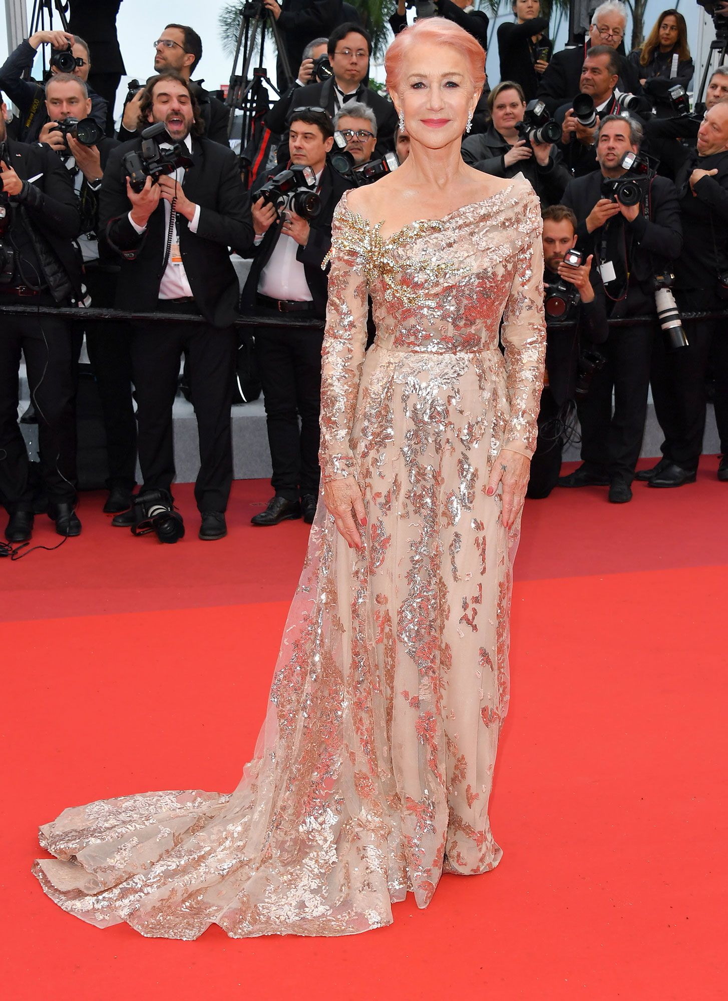 Dame Helen Mirren Stepping Out in Style at Cannes Film Festival - Sure, the Oscar winner's shimmering Elie Saab gown and Chopard jewels at the Les Plus Belles Annees D'Une Vie premiere on Saturday, May 18, were stunning. But we couldn't get enough of her pastel pink 'do.