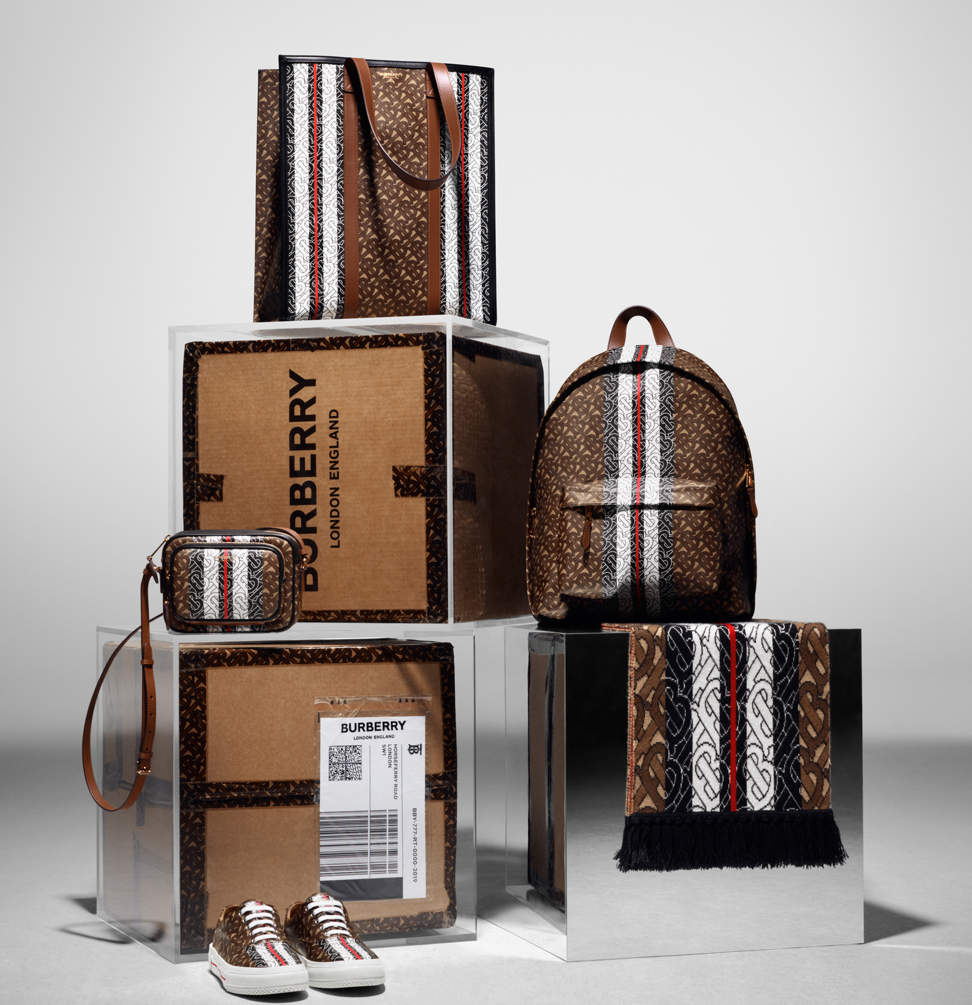 Gigi-Hadid-Gender-Bending-Burberry-Campaign - Among the new accessories in the Thomas Burberry Monogram collection: a tote, backpack, shoulder bag, sneakers and more.