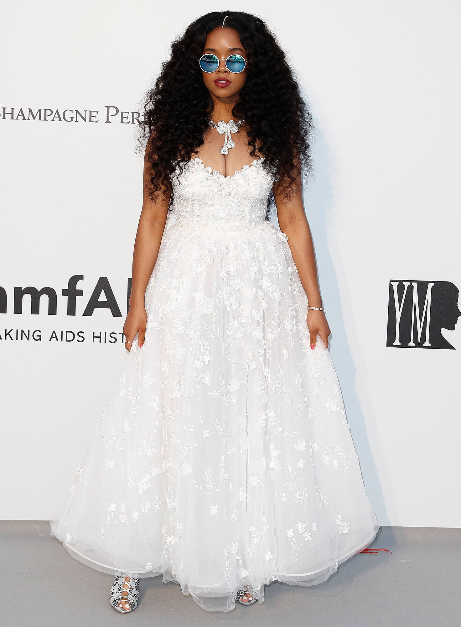 H.E.R. - White hot is the only way to describe the singer's frilly Giambattista Valli x H&M tea-length dress at the amfAR Cannes Gala on Thursday, May 23.