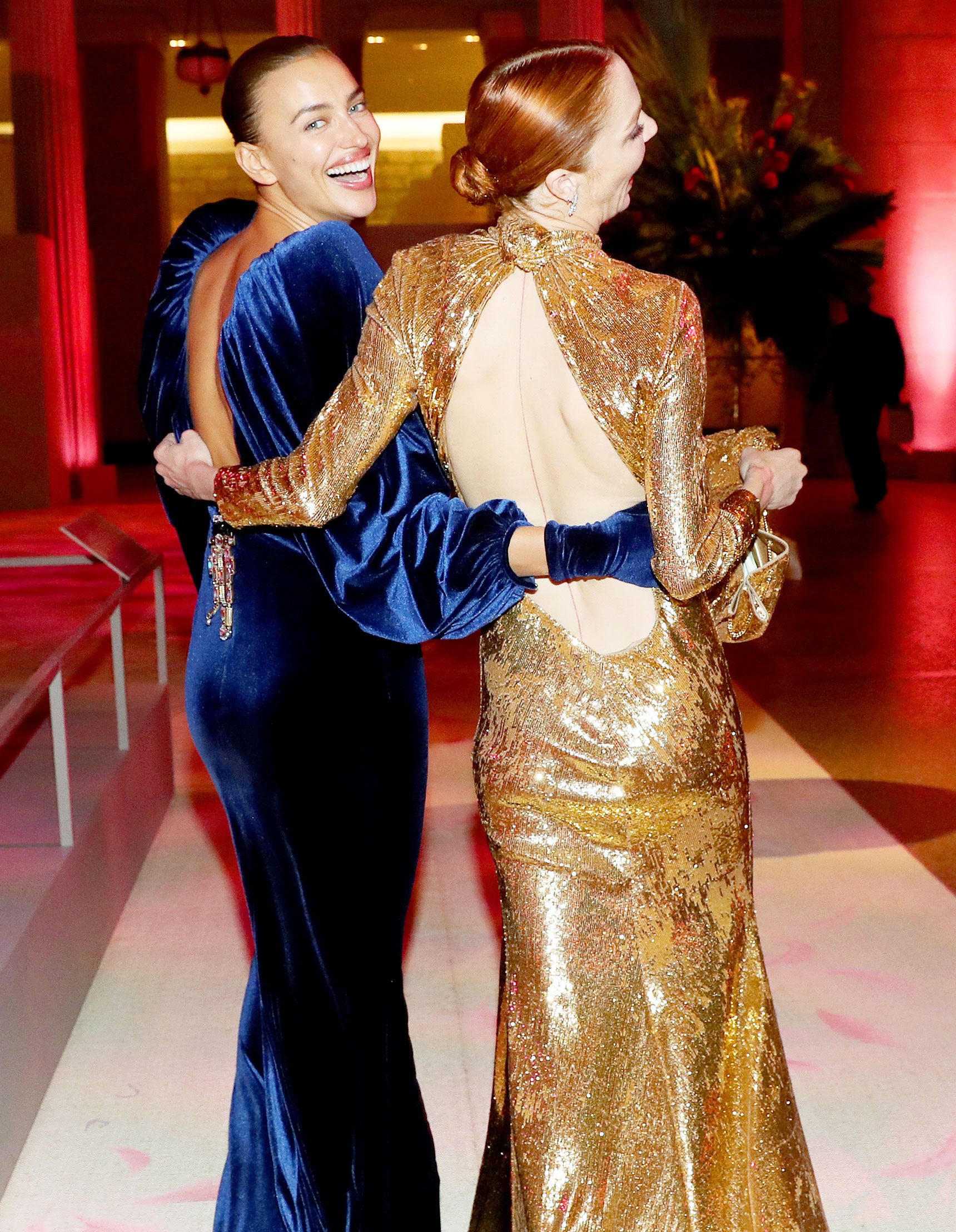 Met Gala 2019 What You Didnt See Irina Shayk Mariacarla Boscono - Irina Shayk and Mariacarla Boscono laughed as they walked into the get-together with their arms around each other.