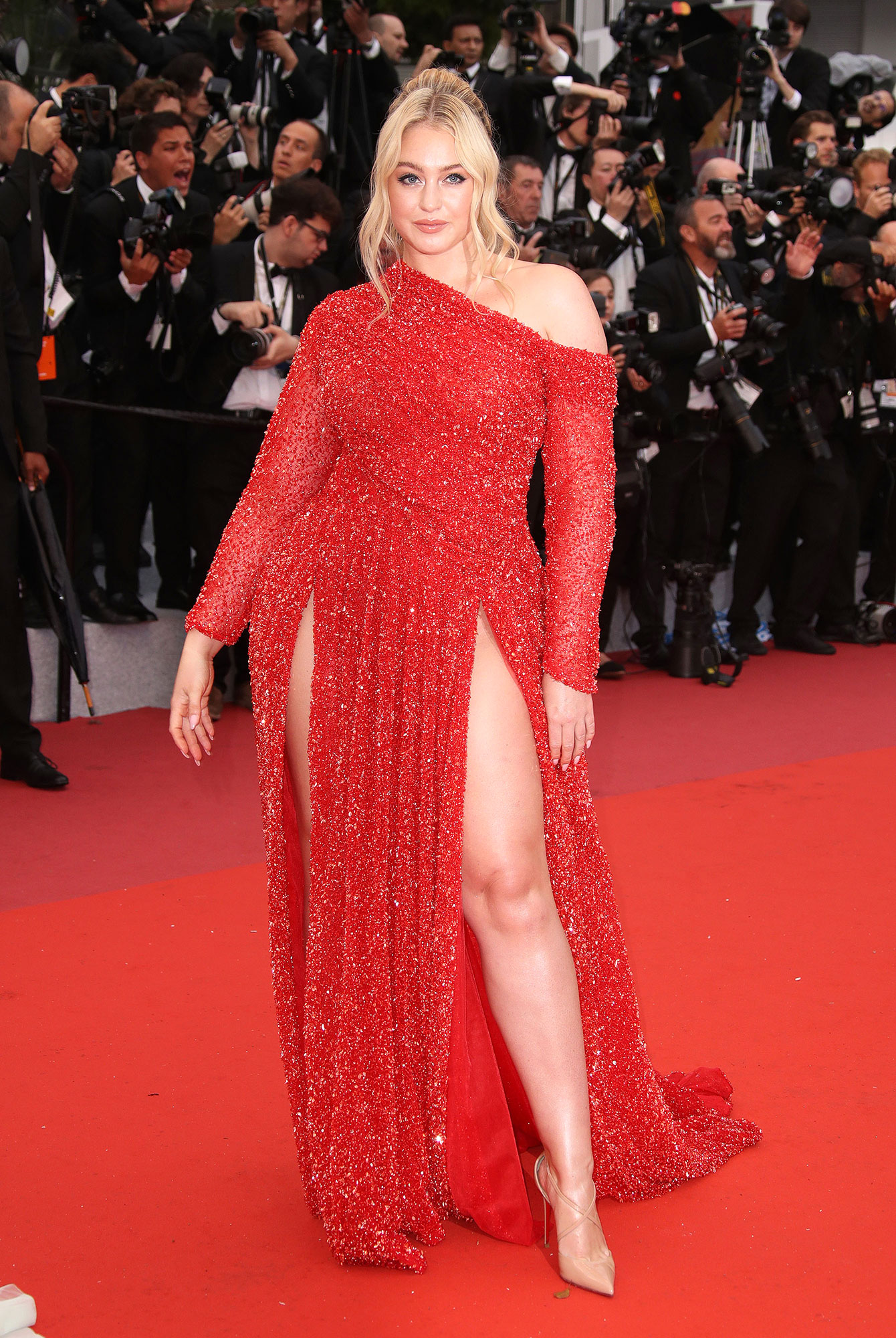 Iskra Lawrence Stepping Out in Style at Cannes Film Festival - The model was red hot on the red carpet in a shimmering Valdrin Sahiti gown and Christian Louboutin pumps at the Les Plus Belles Annees D'Une Vie screening on Saturday, May 18.