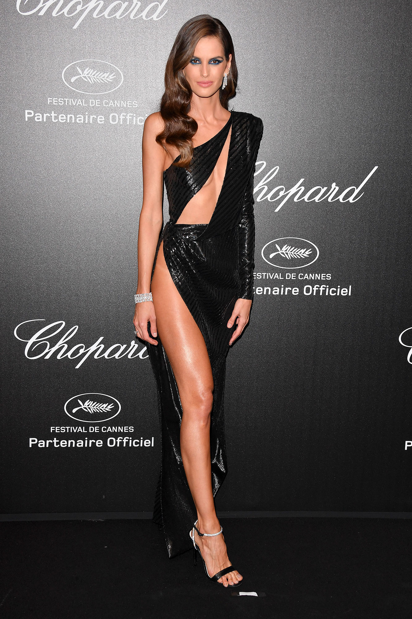 Izabel Goulart Stepping Out in Style at Cannes Film Festival - The model showed some skin in her cut-out Julien Macdonald gown and Chopard bling at the jeweler's party on Friday, May 17.