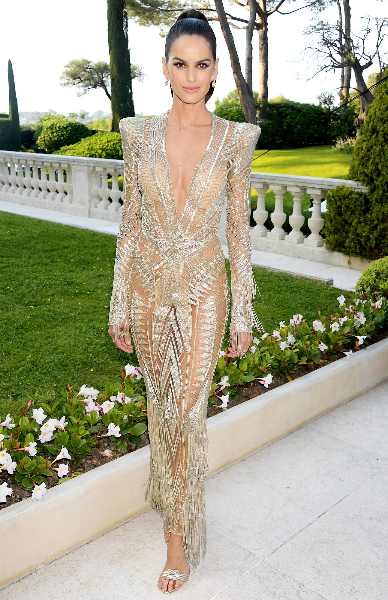 Izabel-Goulart - At the amfAR Cannes Gala on Thursday, May 23, the model showed some serious skin in her nearly naked Julien Macdonald frock.