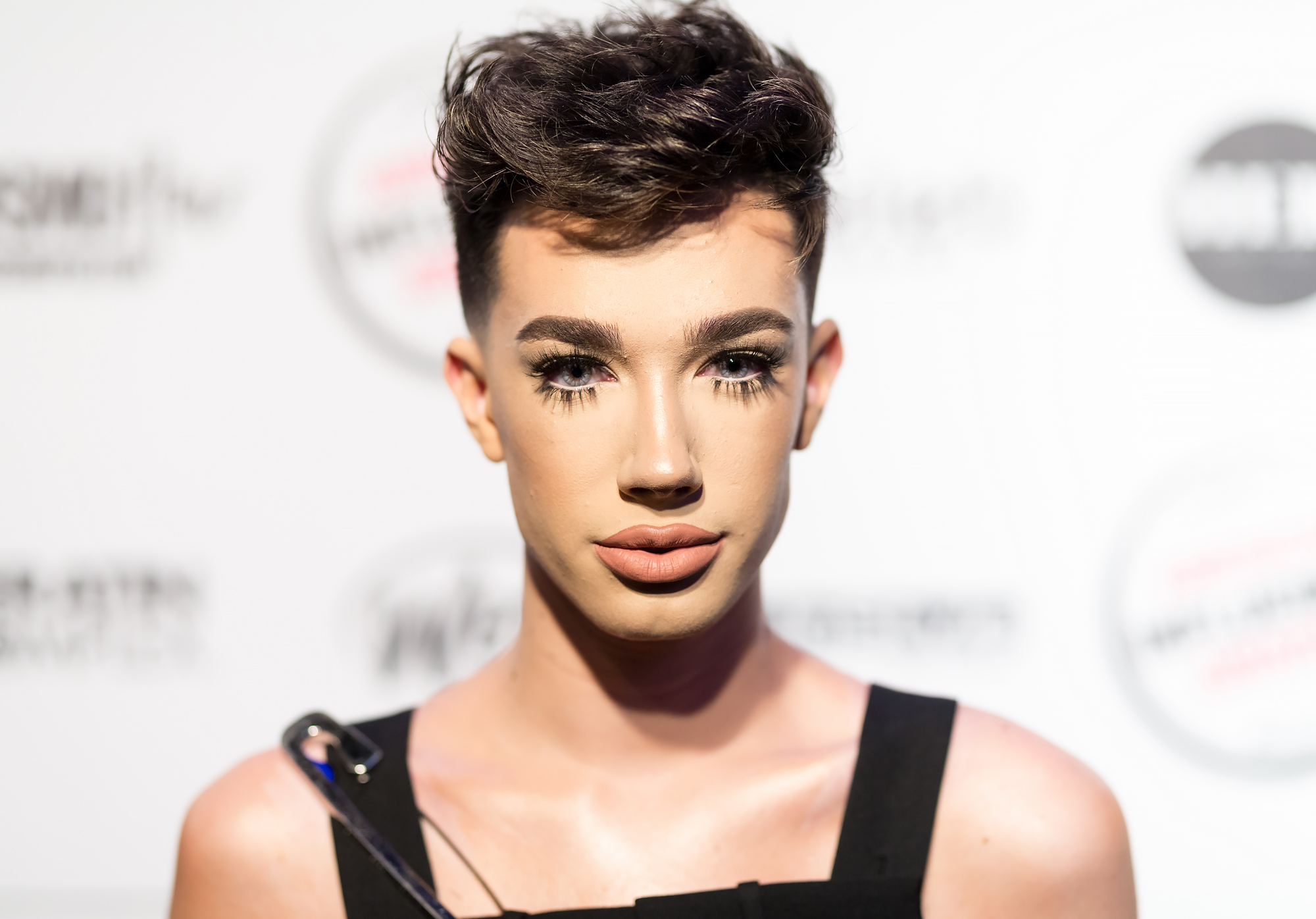 """James-Charles-covergirl - Charles made his mark on the beauty industry when he was named a CoverGirl ambassador in October 2016 at the age of 16. """"Meet @JamesCharles: makeup artist, boundary breaker, and the newest COVERGIRL!"""" the brand wrote on Instagram alongside his campaign photo at the time."""