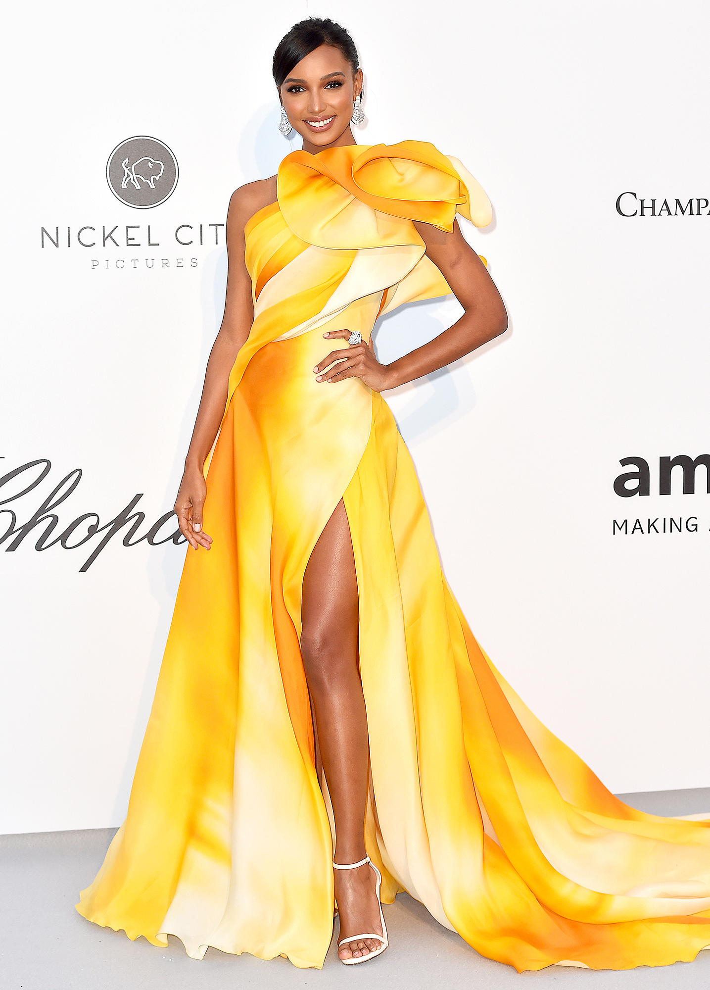 Jasmine-Tookes - Bringing a bit of sunshine to the red carpet, the model stunned in Georges Chakra at the amfAR Cannes Gala on Thursday, May 23.