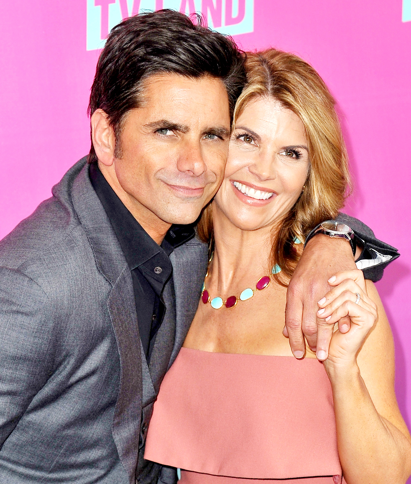 John Stamos Roasted for Including Lori Loughlin in 'Fuller House' Promo Photo: 'Y'all Gonna Be Visiting Aunt Becky in Jail?'