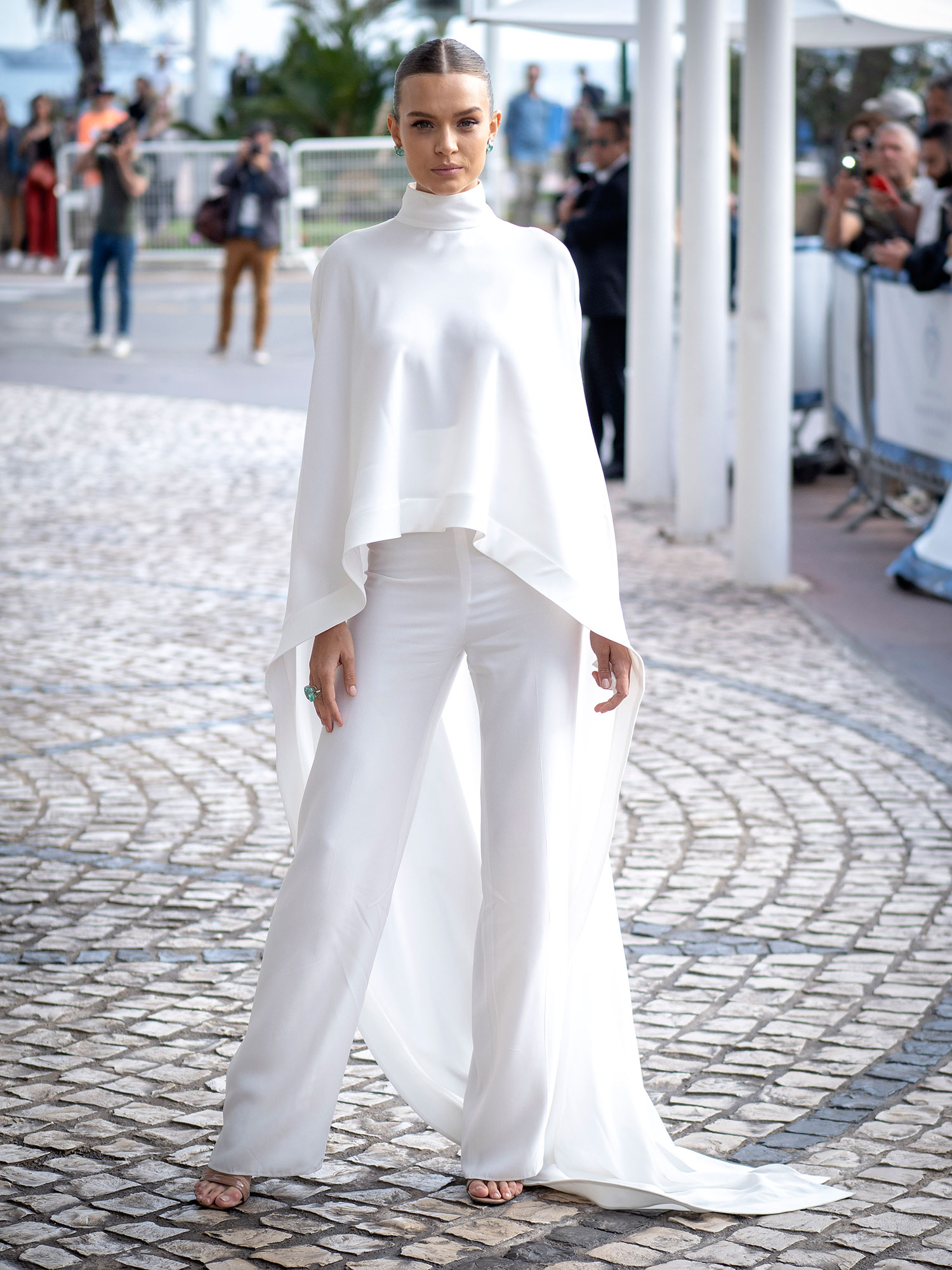Josephine Skriver Memorial Day White - Ideal for chilly summer evening events, this pants-sweater combo seen on the blonde beauty May 22, 2019, is comfy and cute.