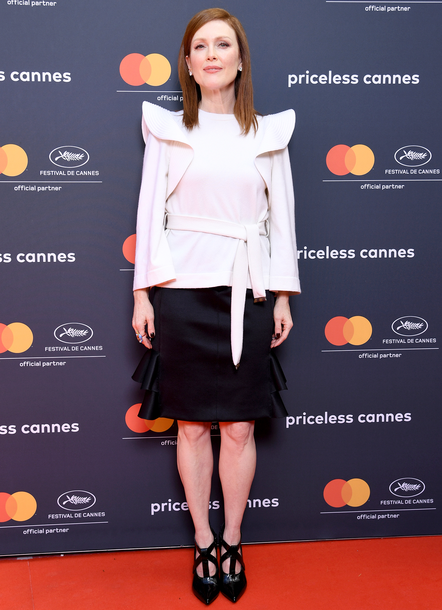 Julianne-Moore - The Oscar winner played with proportion in her structural white top and ruffled miniskirt at the See Life Through A Different Lens photo-call on Wednesday, May 15.