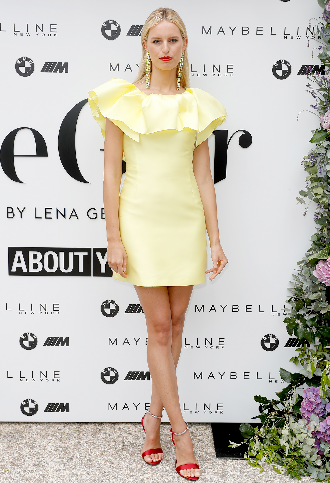 Karolina-Kurkova - The blonde beauty kept things short and sweet in a yellow mini at the Wellbeing Summer Lunch on Wednesday, May 22.