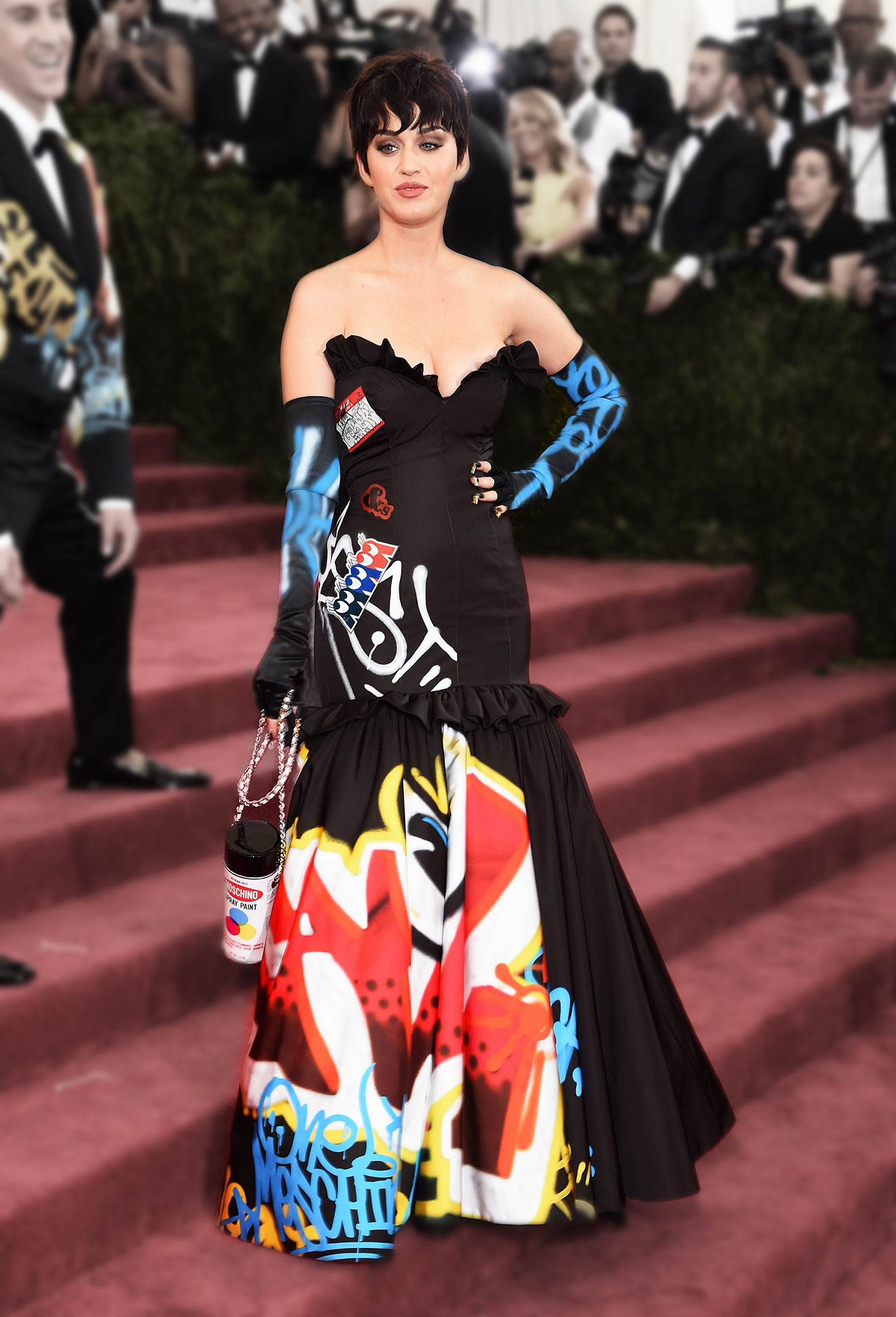 Katy Perry Wore Some of Her Wackiest Outfits Ever to the 2019 Met Gala - Tapping friend Jeremy Scott for her Met Gala look, the brunette beauty went big with black gown covered in graffiti-like print.