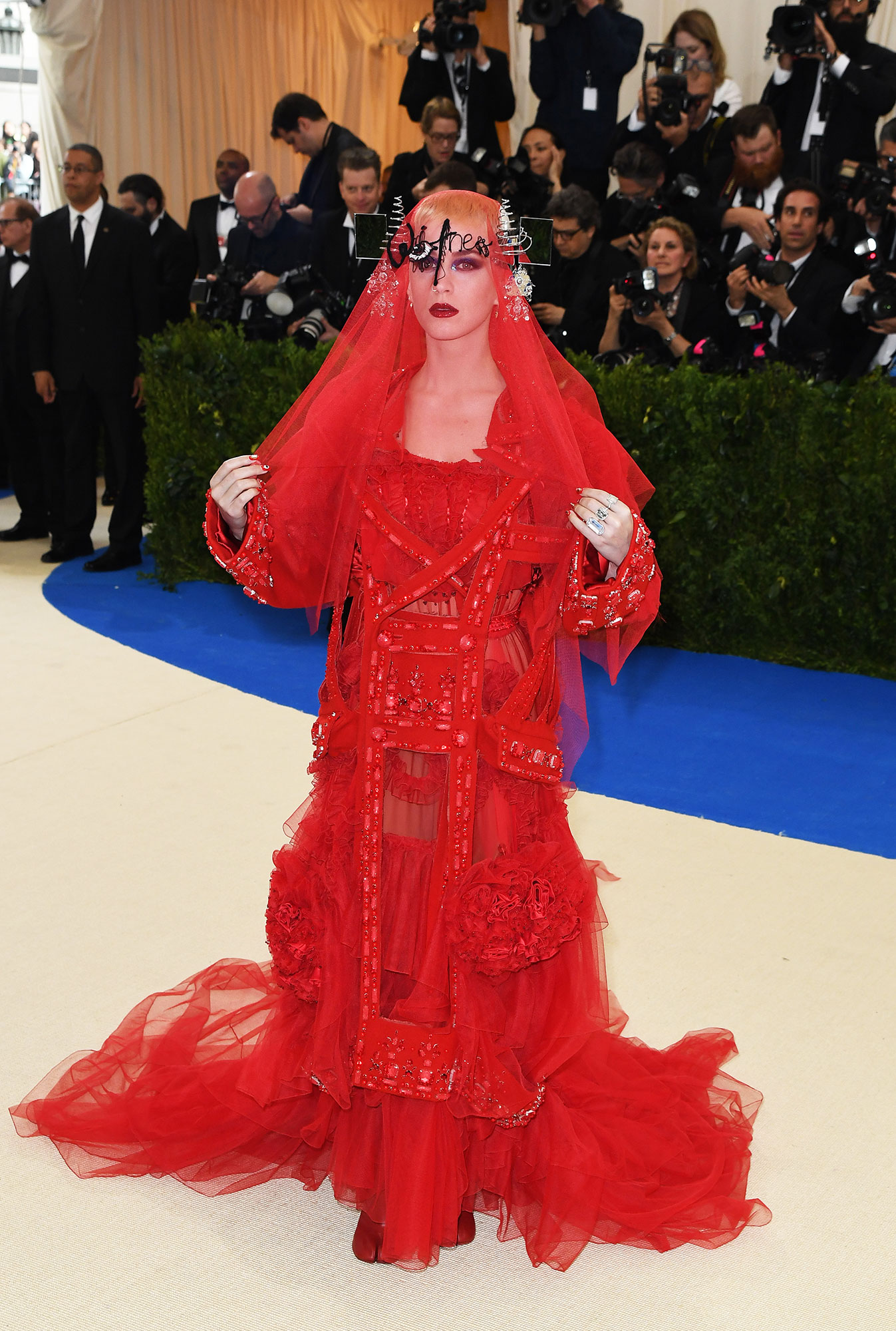 Katy Perry Wore Some of Her Wackiest Outfits Ever to the 2019 Met Gala - With a veil over her face, the songstress wore an avant guard John Galliano red tulle dress to the 2017 Met Gala.