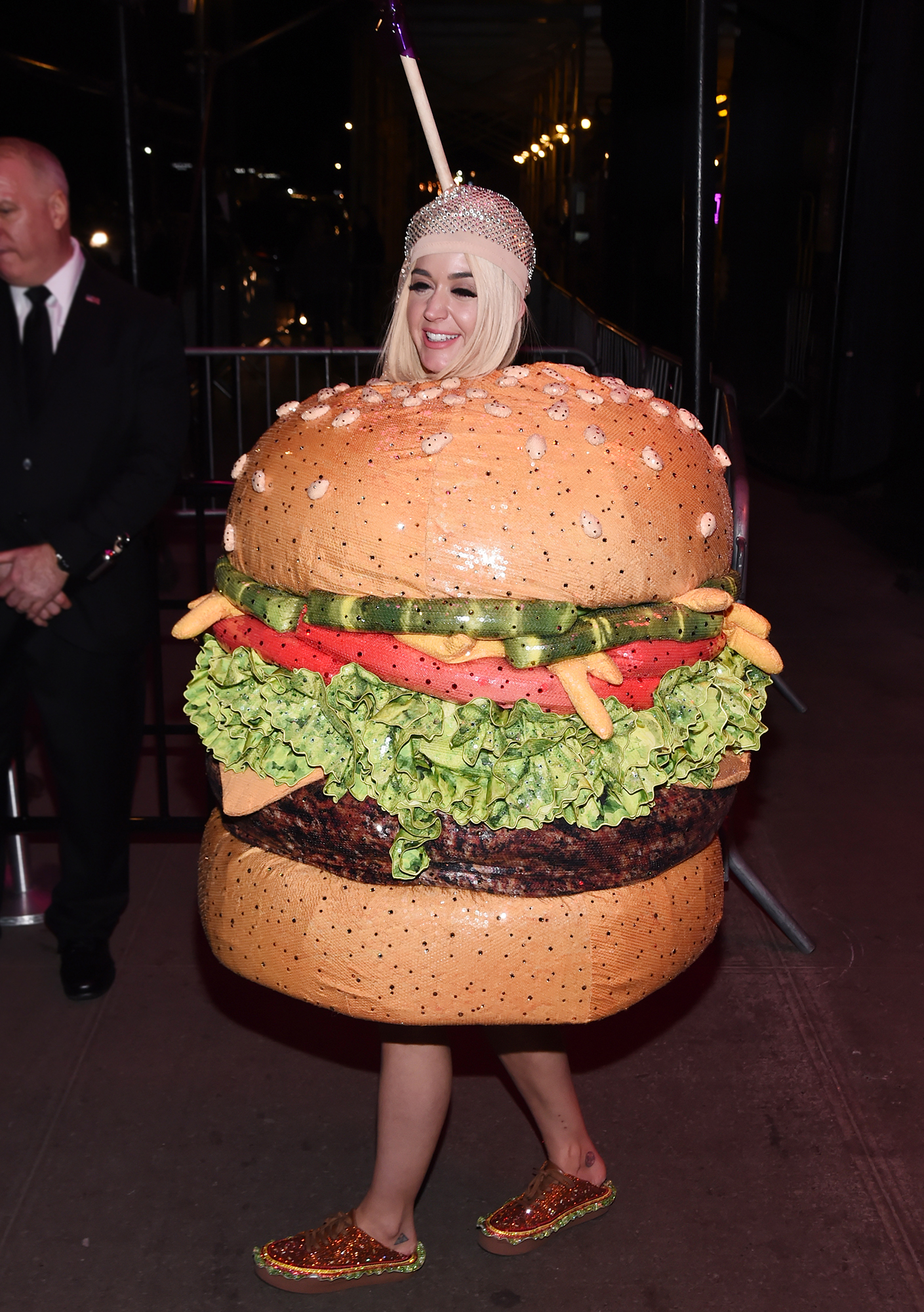 Katy Perry Dressed as Food - The songstress walked the red carpet in an outfit that made her look like a classy lighting fixture, but once inside she changed into a detailed hamburger costume. The number was created by Moschino designer Jeremy Scott, who wore his own hamburger-esque outfit to match his muse's.