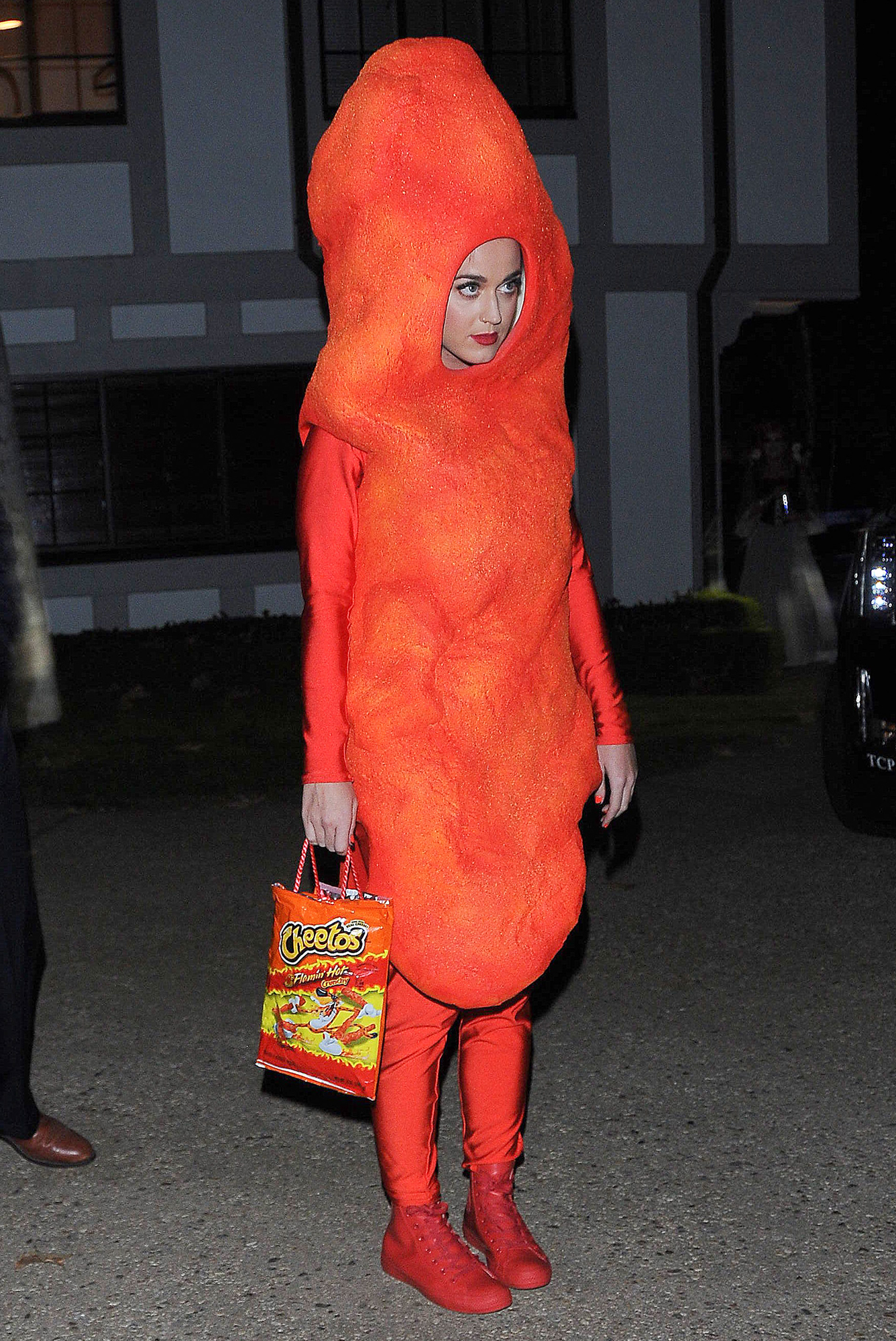 Katy Perry Dressed as Food - The California native dressed up like a Cheeto for Kate Hudson's annual Halloween party in 2014. Her orange outfit included a purse made out of a Cheetos bag.