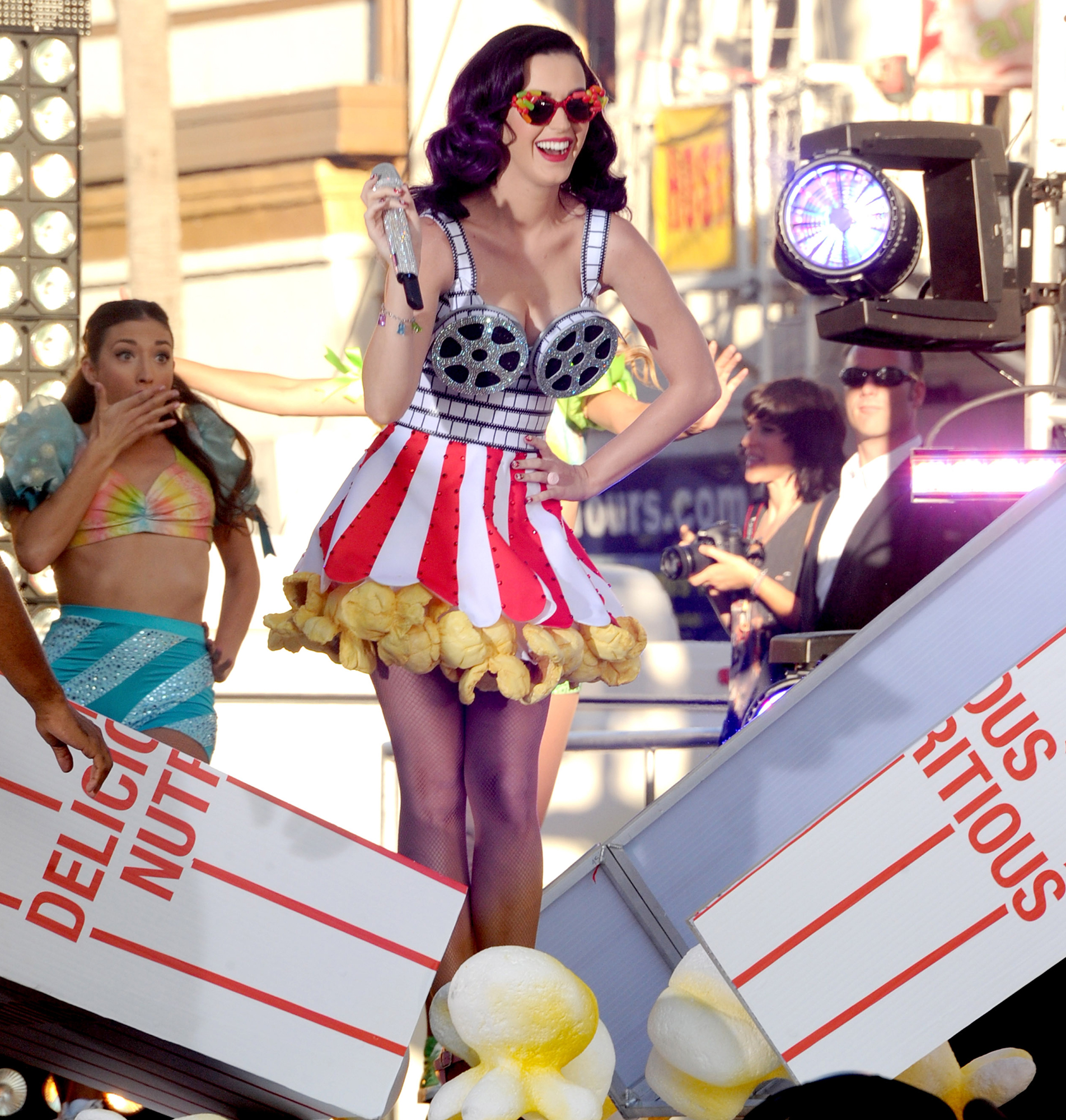 Katy Perry Dressed as Food - Perry performed in Hollywood in 2012 dressed as a carton of movie popcorn. The top of her ensemble was made to look like a film strip, while the bottom featured buttered popcorn kernels dangling from it.