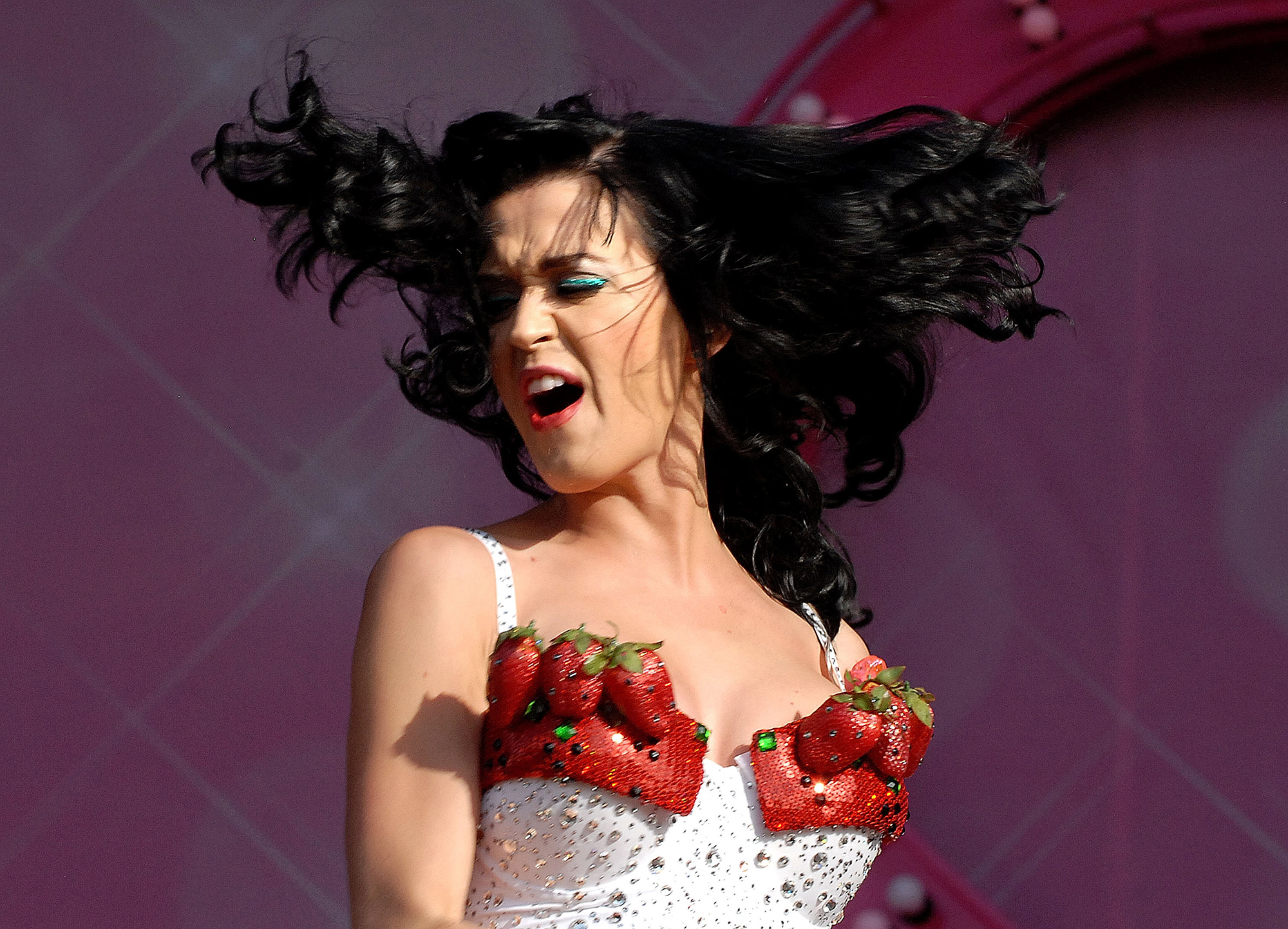 Katy Perry Dressed as Food - To take part in England's V Festival in August 2009, the singer wore a white and red outfit with strawberry-esque details. The bust even featured realistic seeds and life-size versions of the fruit.