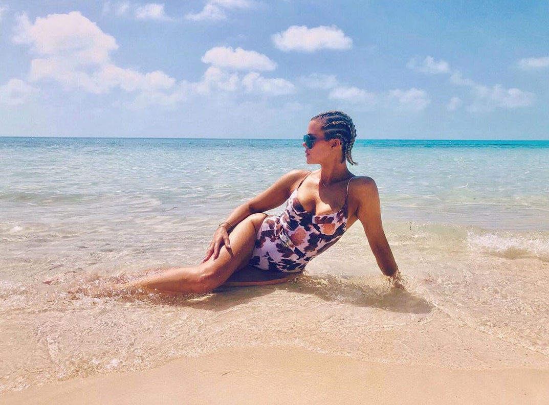 "Khloe Kardashian and Daughter True Hit the Beach in Turks and Caicos - The TV personality posed in the water and confessed, ""I never want to leave."""