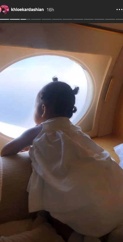 Khloe Kardashian and Daughter True Hit the Beach in Turks and Caicos - True peered out the window while on a plane to her tropical destination.