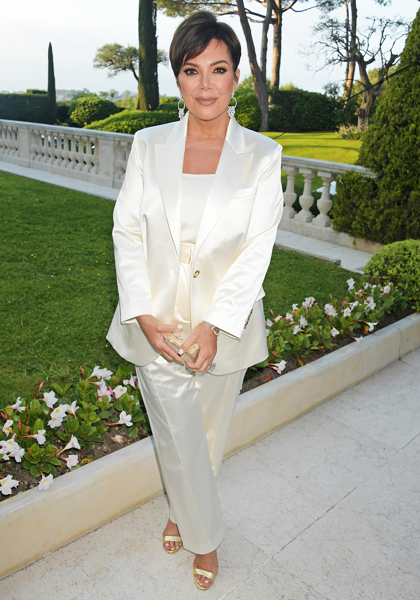 Kris-Jenner - The Keeping Up With the Kardashians star opted for a boss-lady pantsuit at the amfAR Cannes Gala on Thursday, May 23.