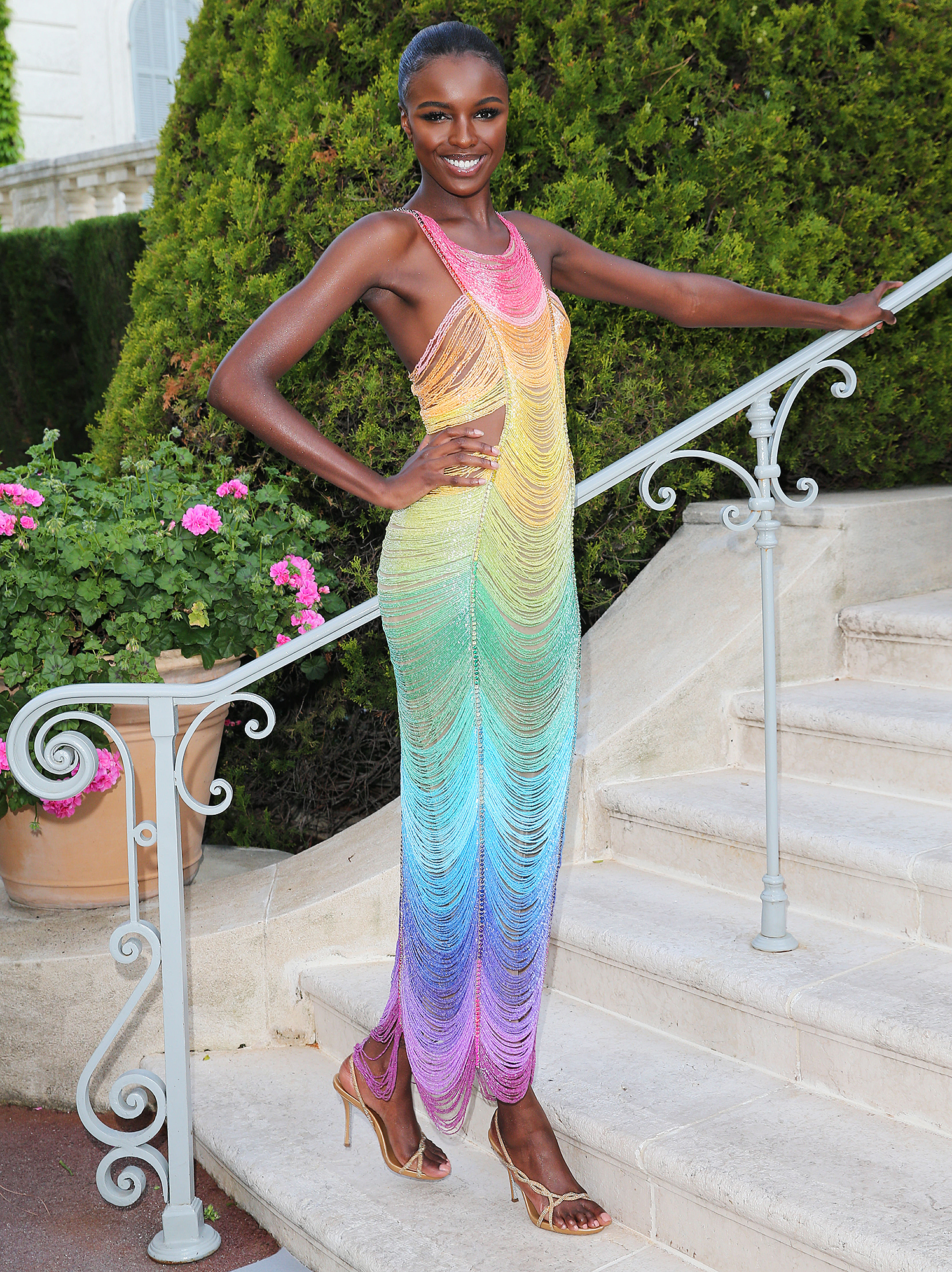 Leomie-Anderson - A rainbow IRL, the Victoria's Secret model stunned in a colorful Rami Kadi gown at the amfAR Cannes Gala on Thursday, May 23.