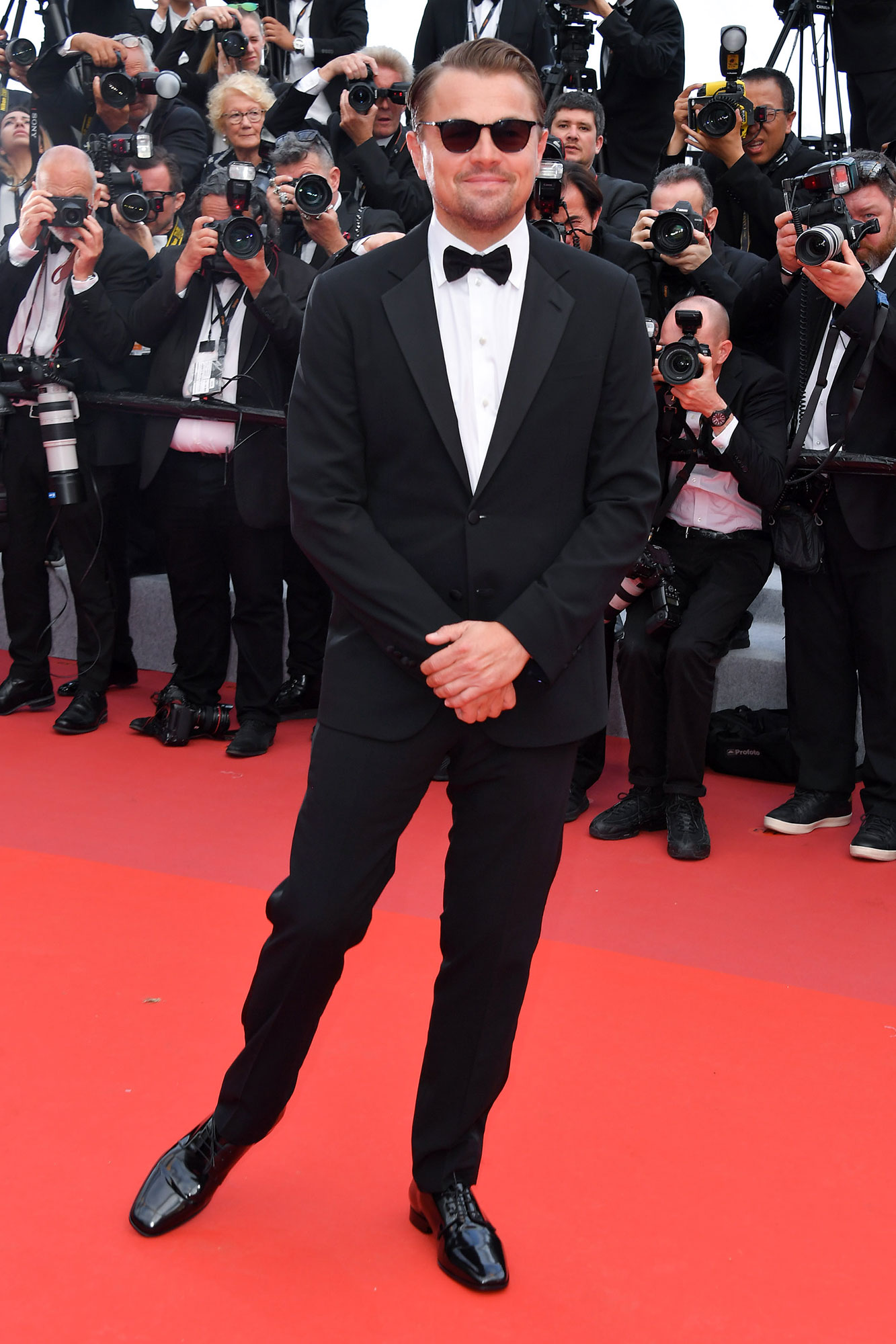 Leonardo DiCaprio Cannes Film Festival 2019 Most Stylish Guys Red Carpet - Wayfarer shades added a cool touch to the actor's timeless black tux at the Once Upon a Time in Hollywood screening on Tuesday, May 21.