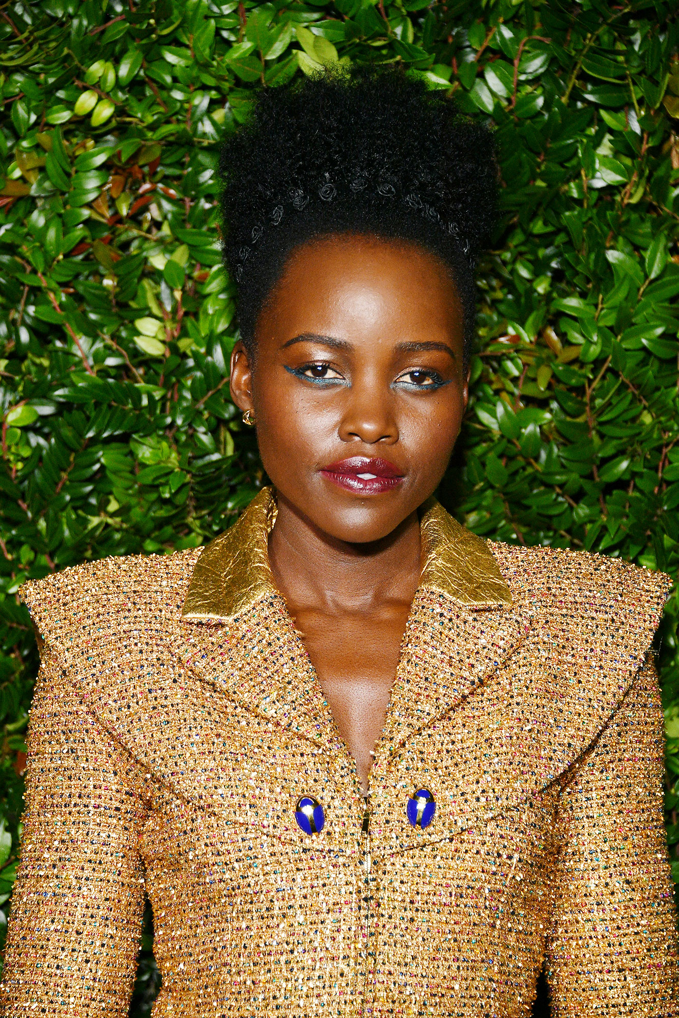 Lupita Nyong'o Fresh Cat Eye - The wing doesn't have to come from the top lash line, as the Black Panther star showcased at the Chanel And Charles Finch Pre-Oscar Awards Dinner on February 23, 2019, using a metallic turquoise liner.