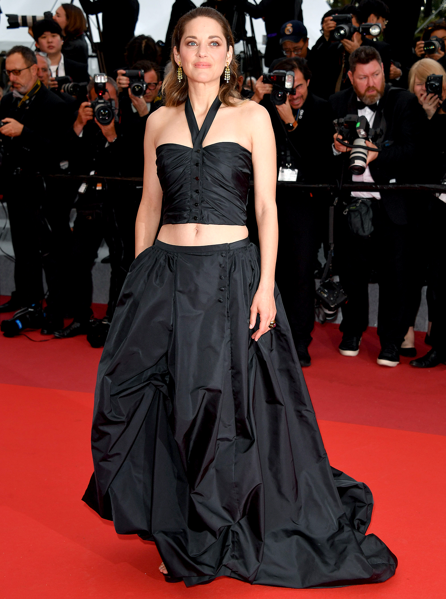 Marion-Cotillard - It was all about the vintage vibes for the actress at the Le Belle Epoque screening on Monday, May 20. She flashed her abs in an archival Chanel two-piece.