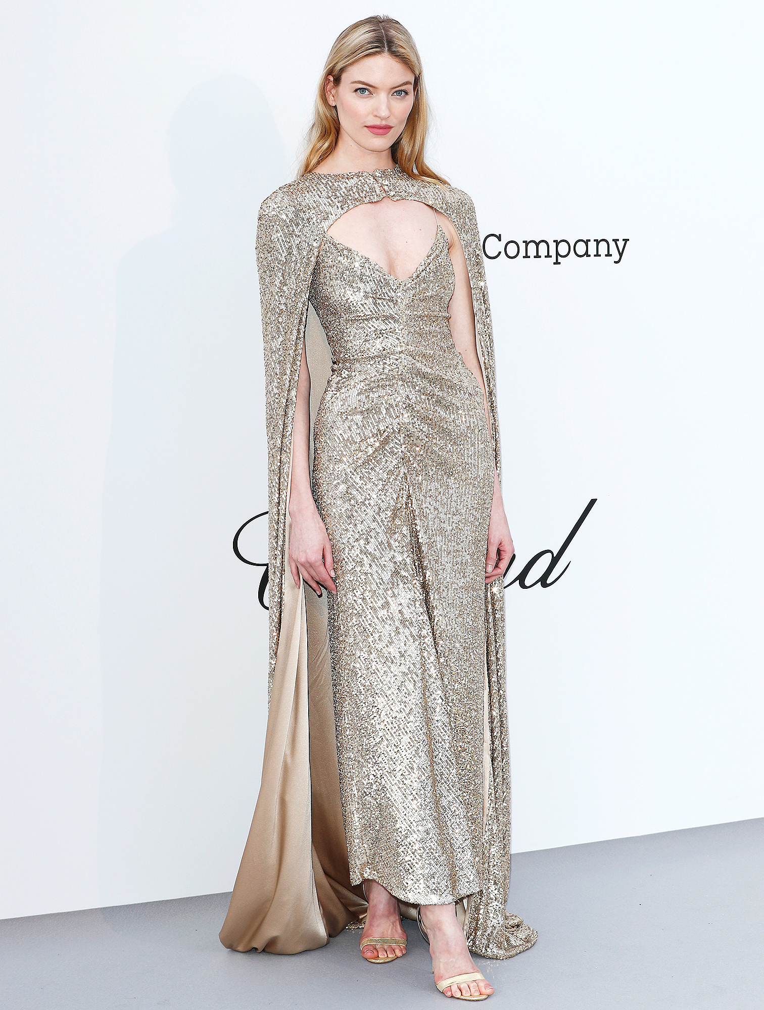 Martha-Hunt - At the amfAR Cannes Gala on Thursday, May 23, the model was a golden goddess in sparkling Monique Lhuillier.