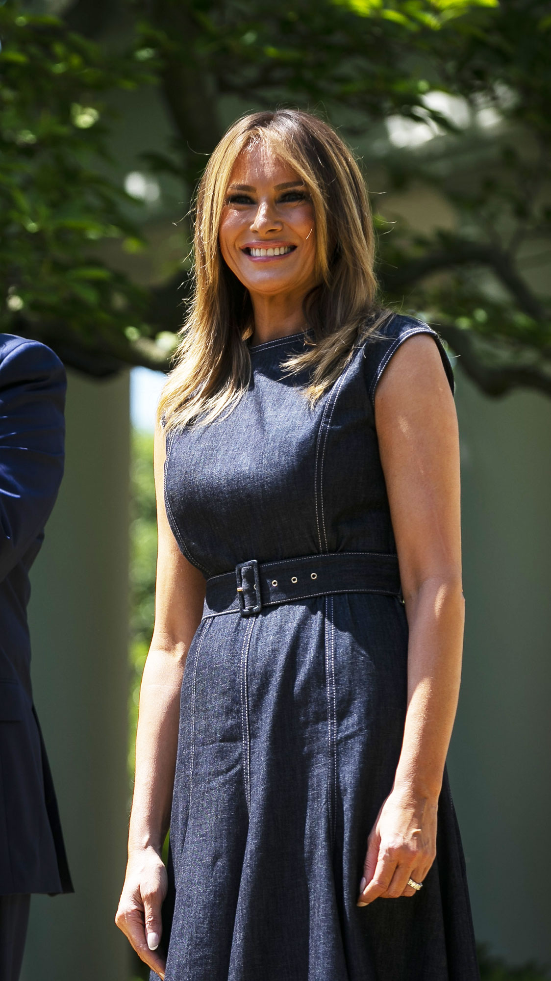 "Melania Trump Takes a Page From Duchess Kate by Wearing This Designer - U.S. President Donald Trump applauds as First Lady Melania Trump smiles during a ""Be Best"" initiative event in the Rose Garden of the White House in Washington, D.C., U.S., on Tuesday, May 7, 2018."