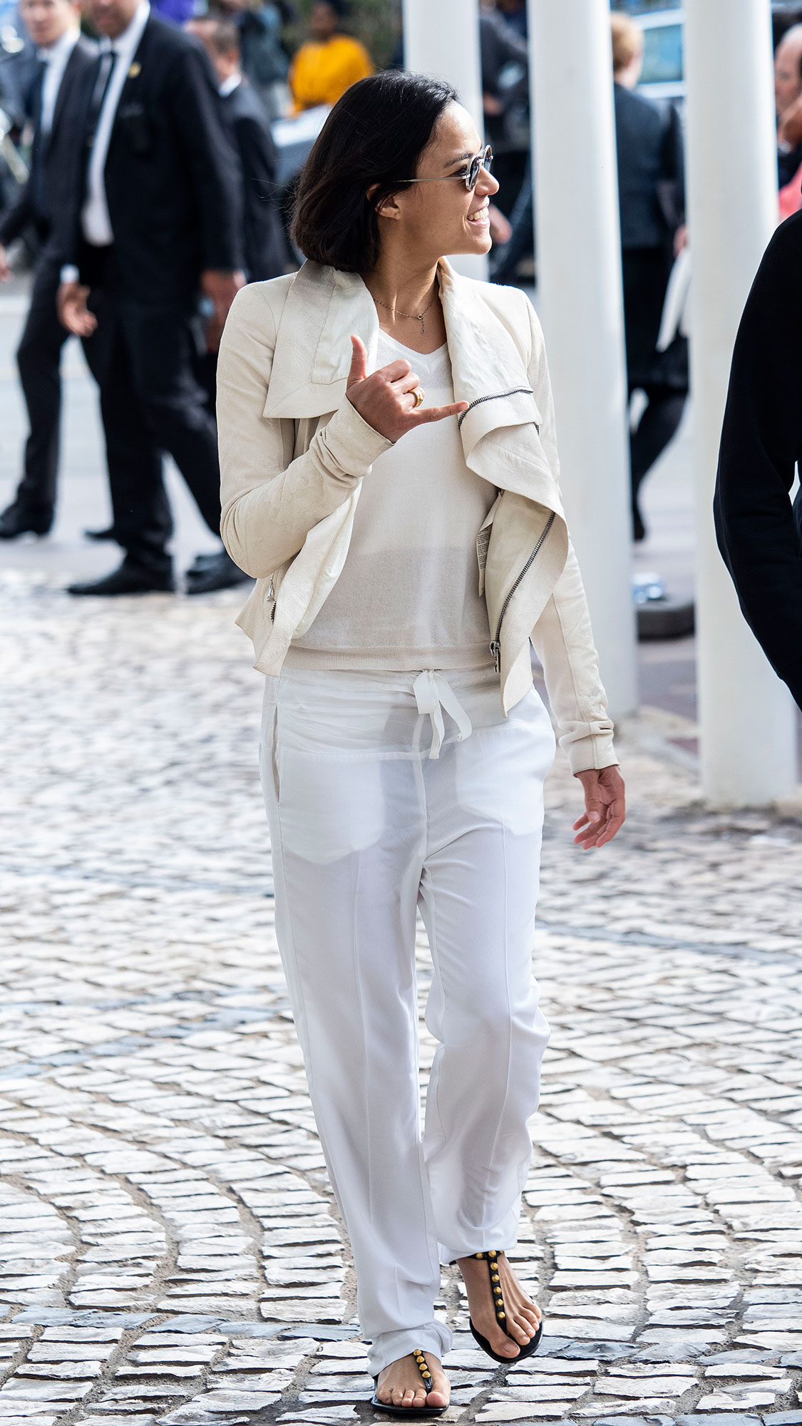 Michelle Rodriguez Memorial Day White - Hanging out between events at the Cannes Film Festival, the actress gave Us the ultimate summer day inspo in linen pants, sandals and a white tee on May 20, 2019.