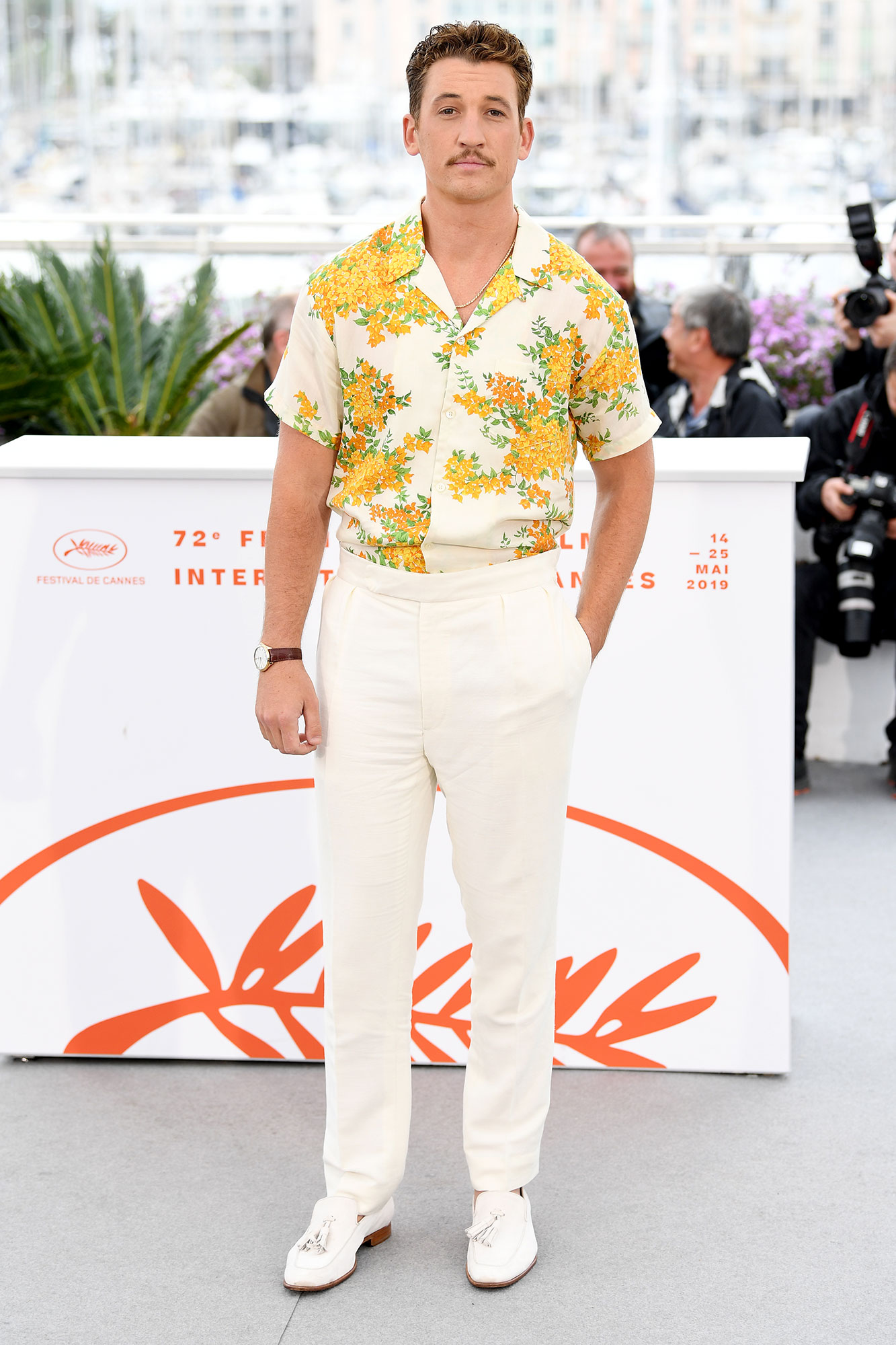 Miles Teller Cannes Film Festival 2019 Most Stylish Guys Red Carpet - It was all about the flower power for the Too Old to Die Young star at the photo-call for the film on Saturday, May 18.