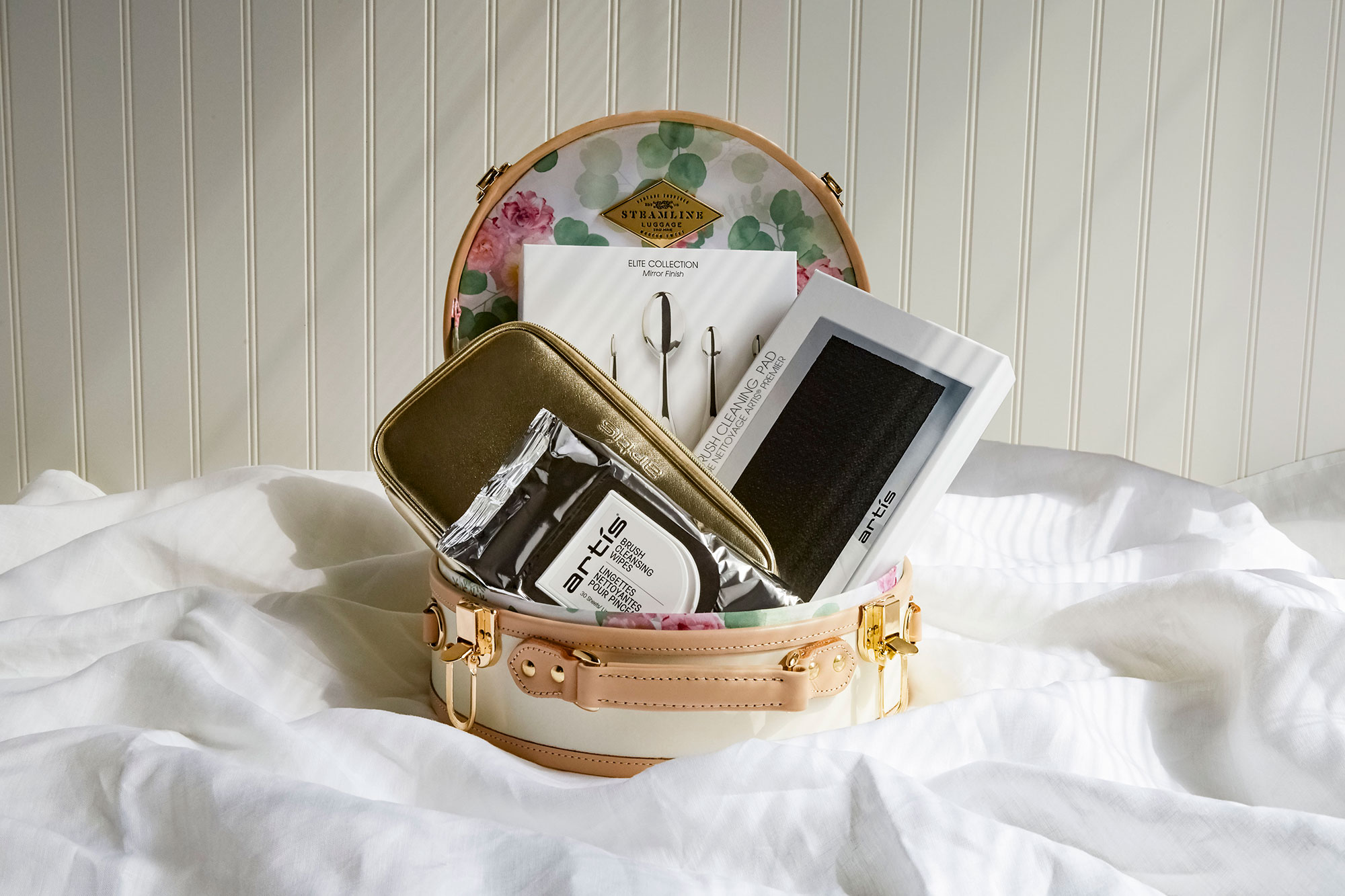 Mother's Day Gift Guide Artis The Queen Mother Gift Set - The innovative makeup brush and skincare brand teamed with the travel experts at SteamLine Luggage to create this posh kit that includes a retro-glam hat box filled with luxe brushes and accessories. $400, artisbrush.com