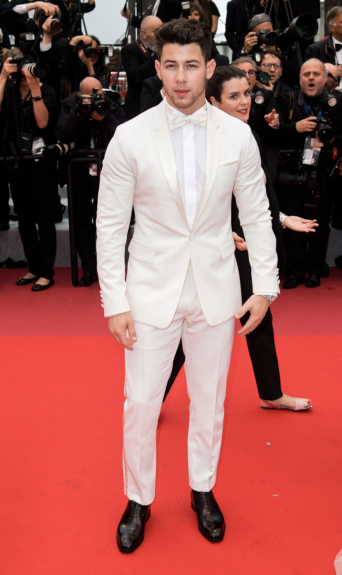 Nick Jonas Cannes Film Festival 2019 Most Stylish Guys Red Carpet - The Jonas Brother accessorized his all-white-everything ensemble with black brogues and Chopard jewels at the Les Plus Belles Annees d'Une Vie screening on Saturday, May 18.