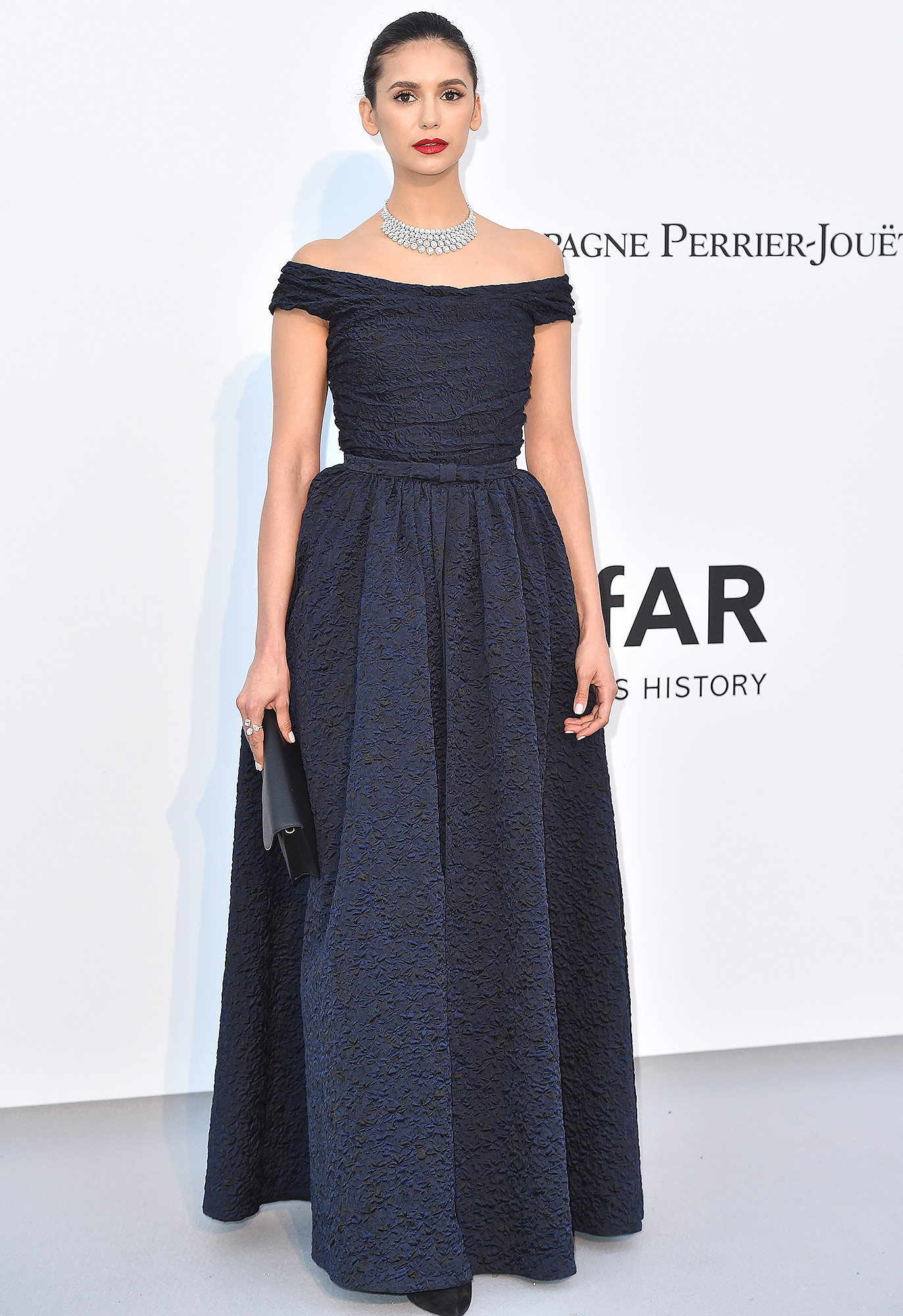 Nina-Dobrev - A darling in Dior at the amfAR Cannes Gala on Thursday, May 23, the brunette beauty accessories with blinding bling and a bright red pout.